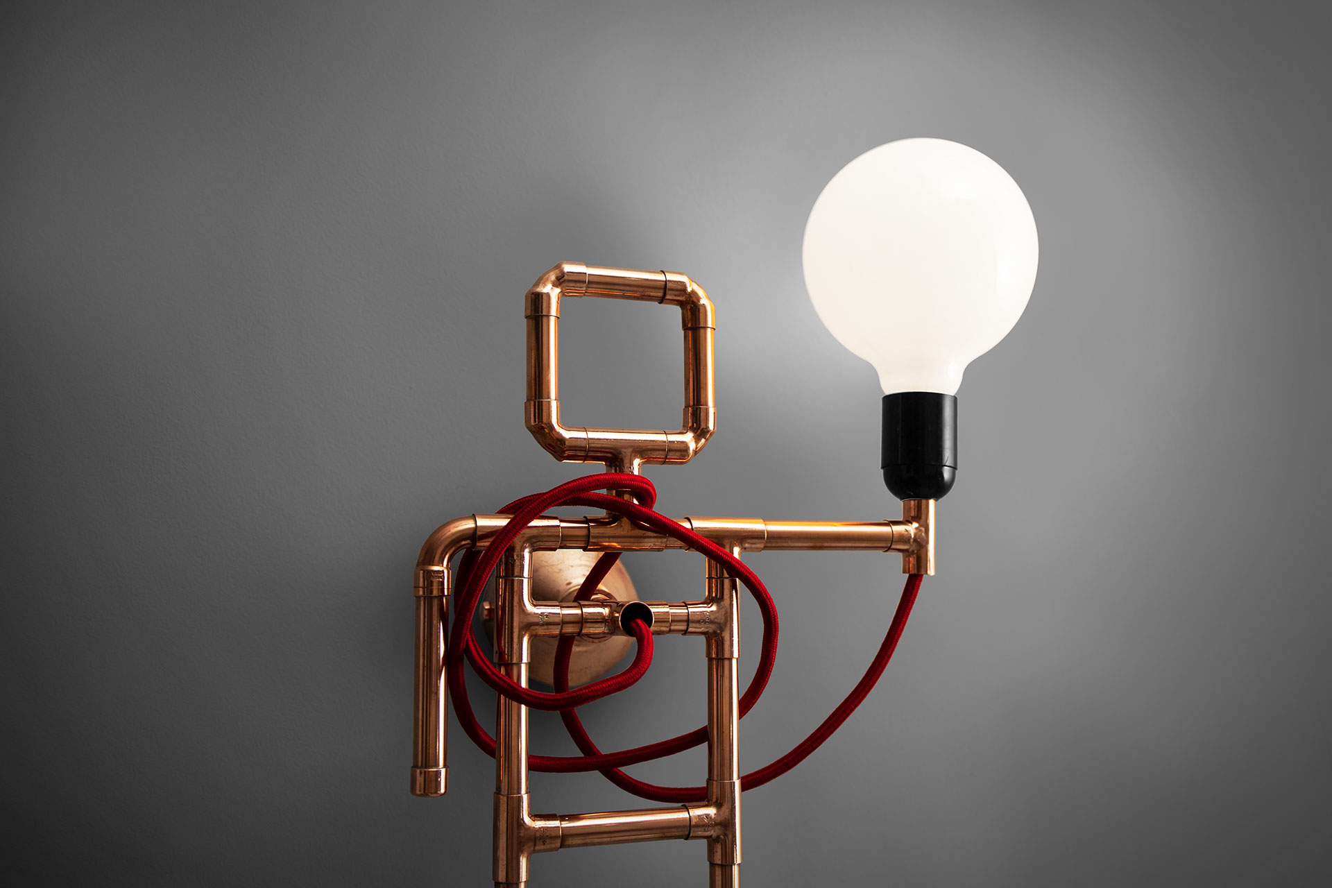 Art wall lamp inspired by industrial design