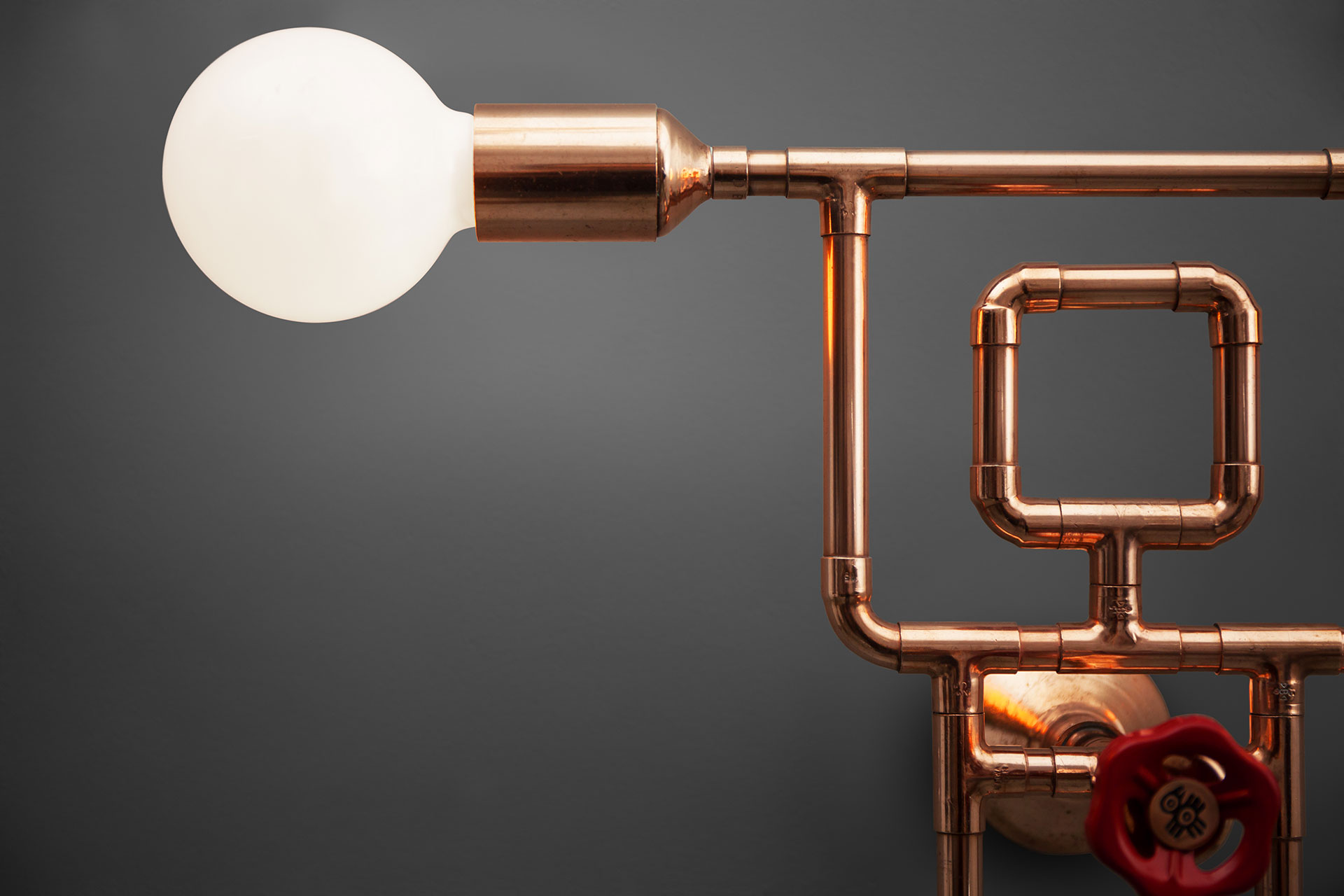 Industrial design gym guy sconce in copper or brass
