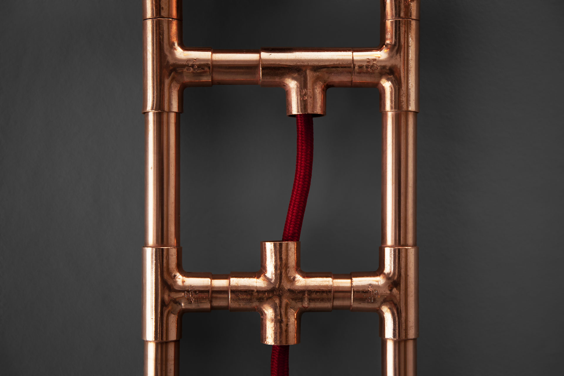 Copper pipe wall lamp with red cord