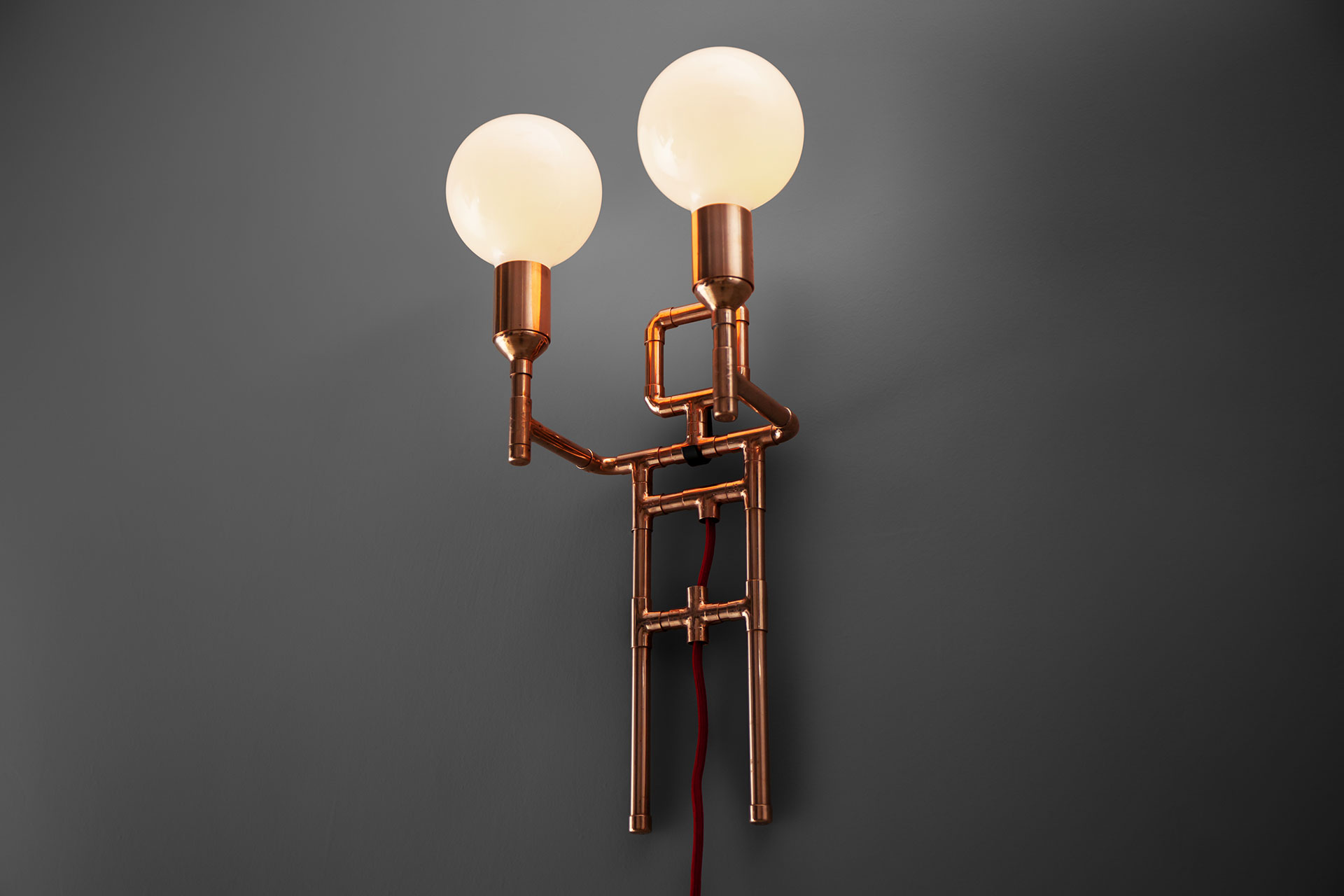Cool designers sconce in copper or brass