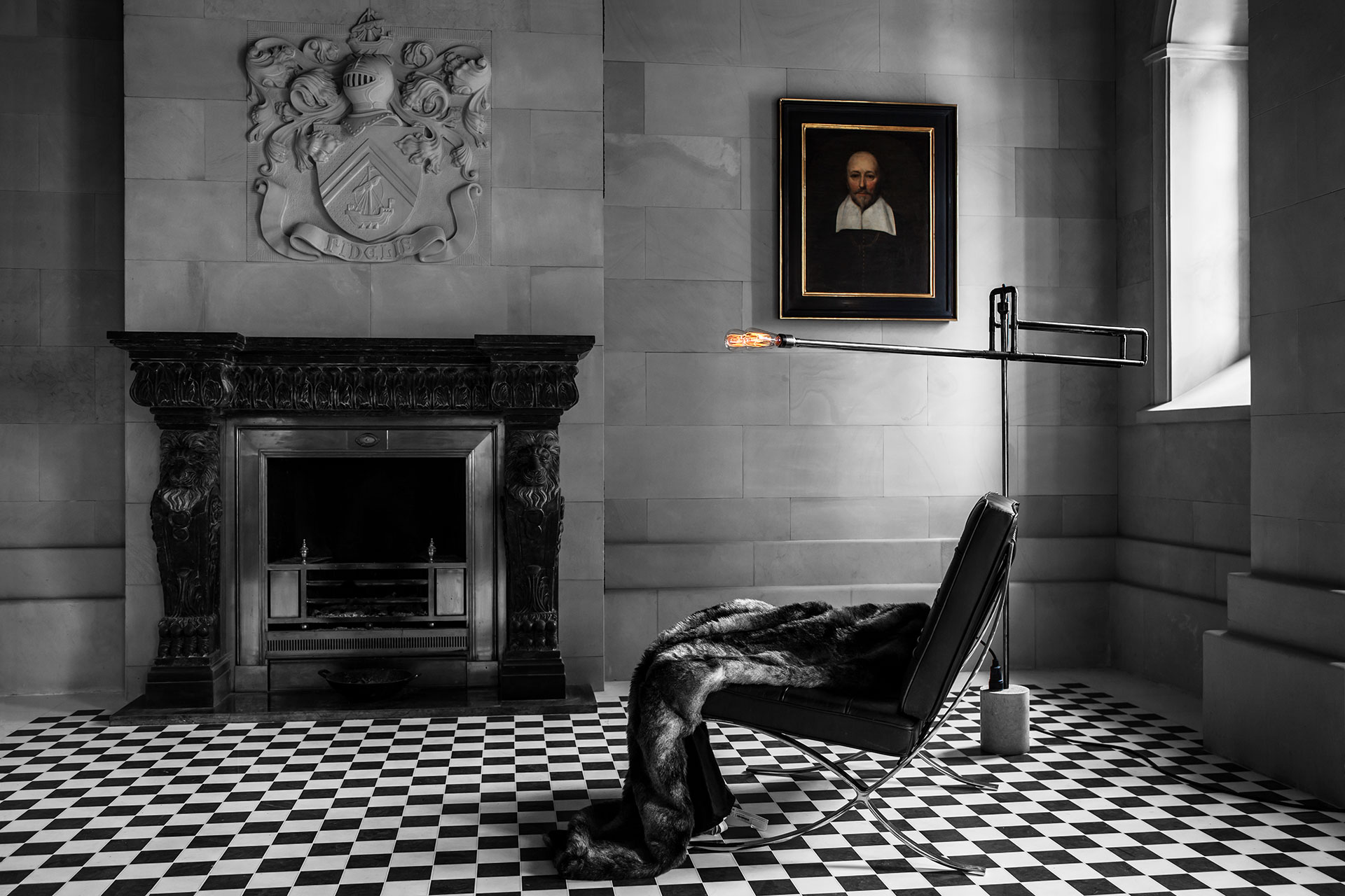 Designer lighting floor lamp in black patina mixed with traditional old castle interior