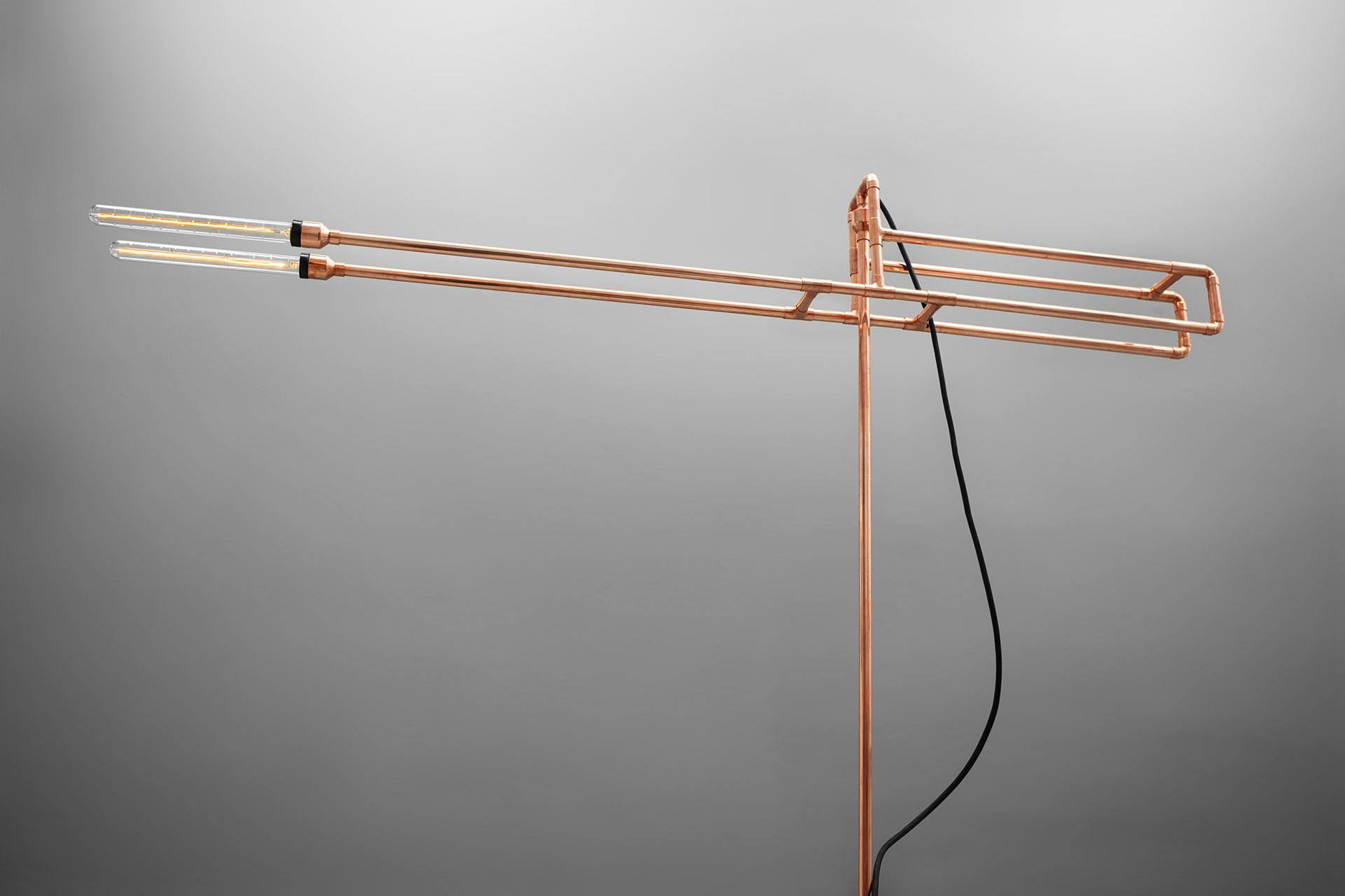 Conceptual design floor lamp in trendy copper or gold brass inspired by copper pipe art