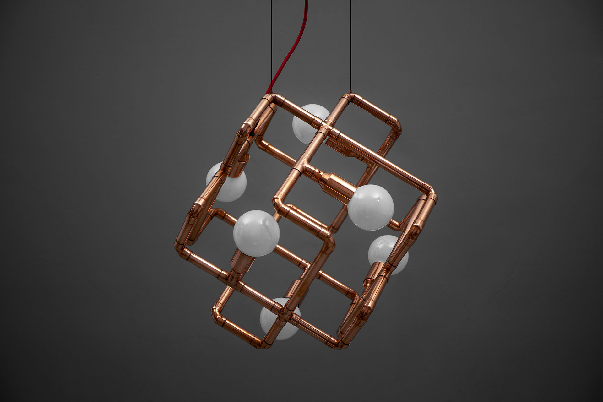 Large 6-lights chandelier in trendy copper or brass in loft style interior