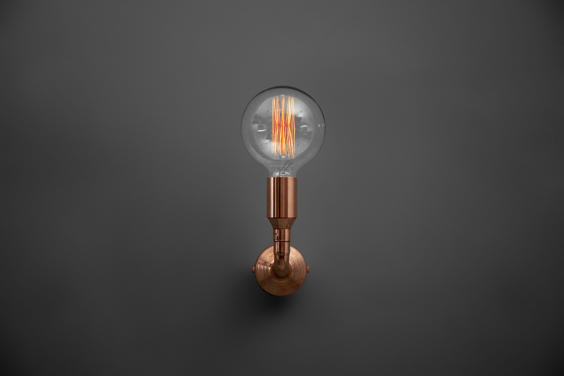 Industrial design copper sconce with vintage Edison bulb