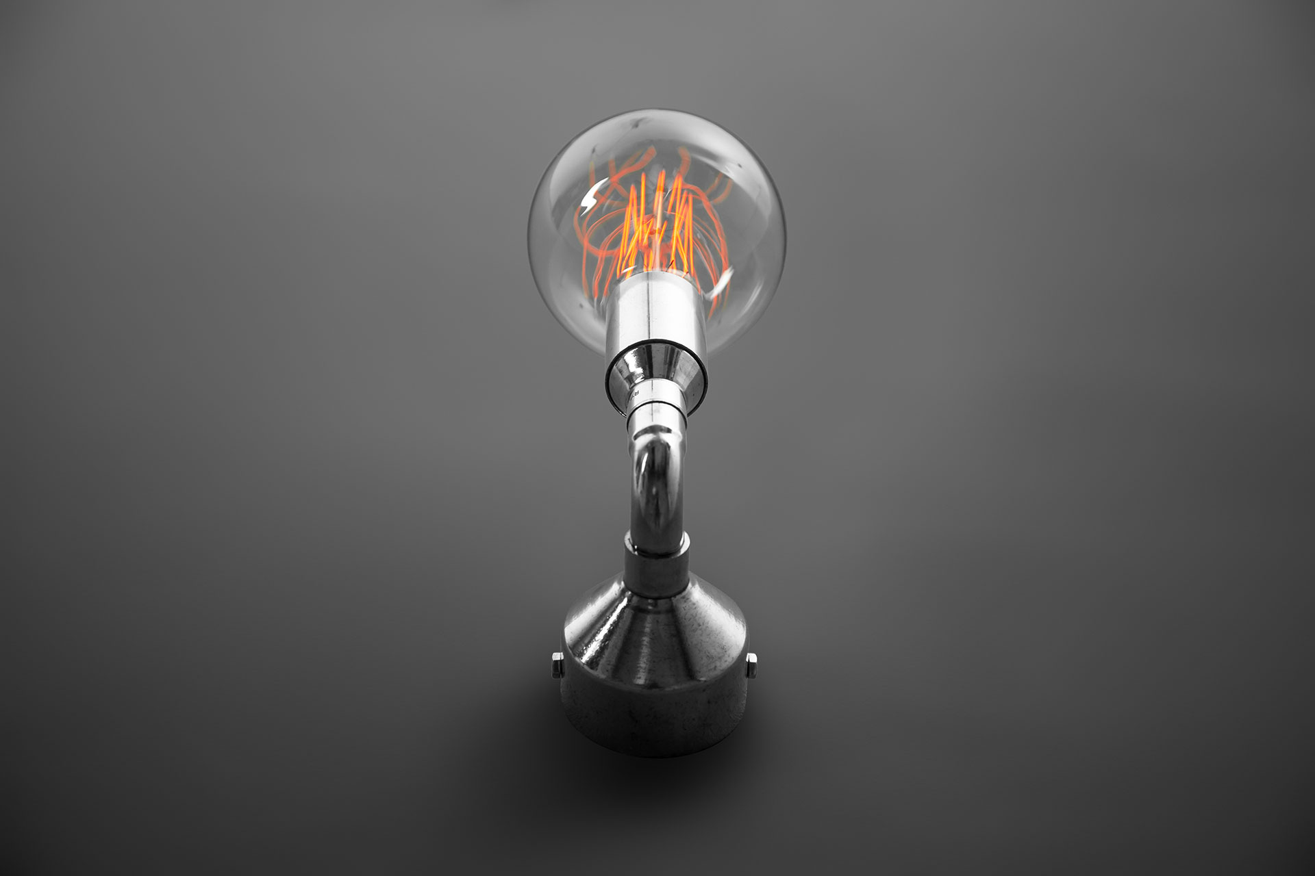 Small silver sconce in loft lighting style