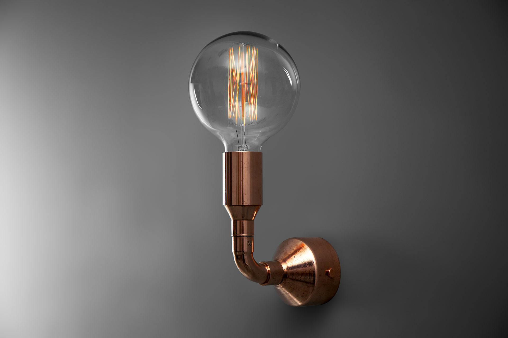 Copper tubing wall lamp with vintage Edison bulb