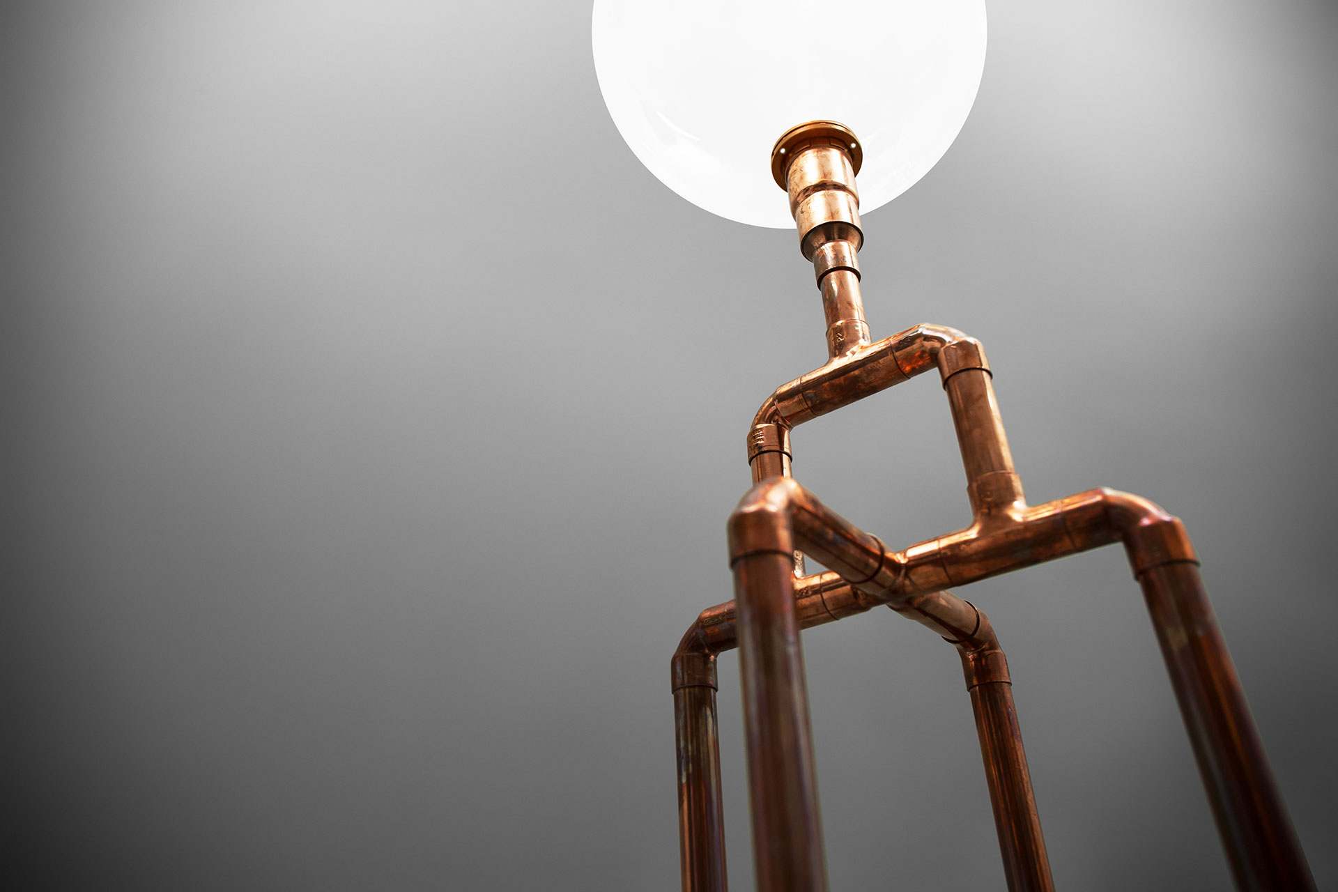 Cool industrial floor lamp made of copper pipes inspired by Art Deco era
