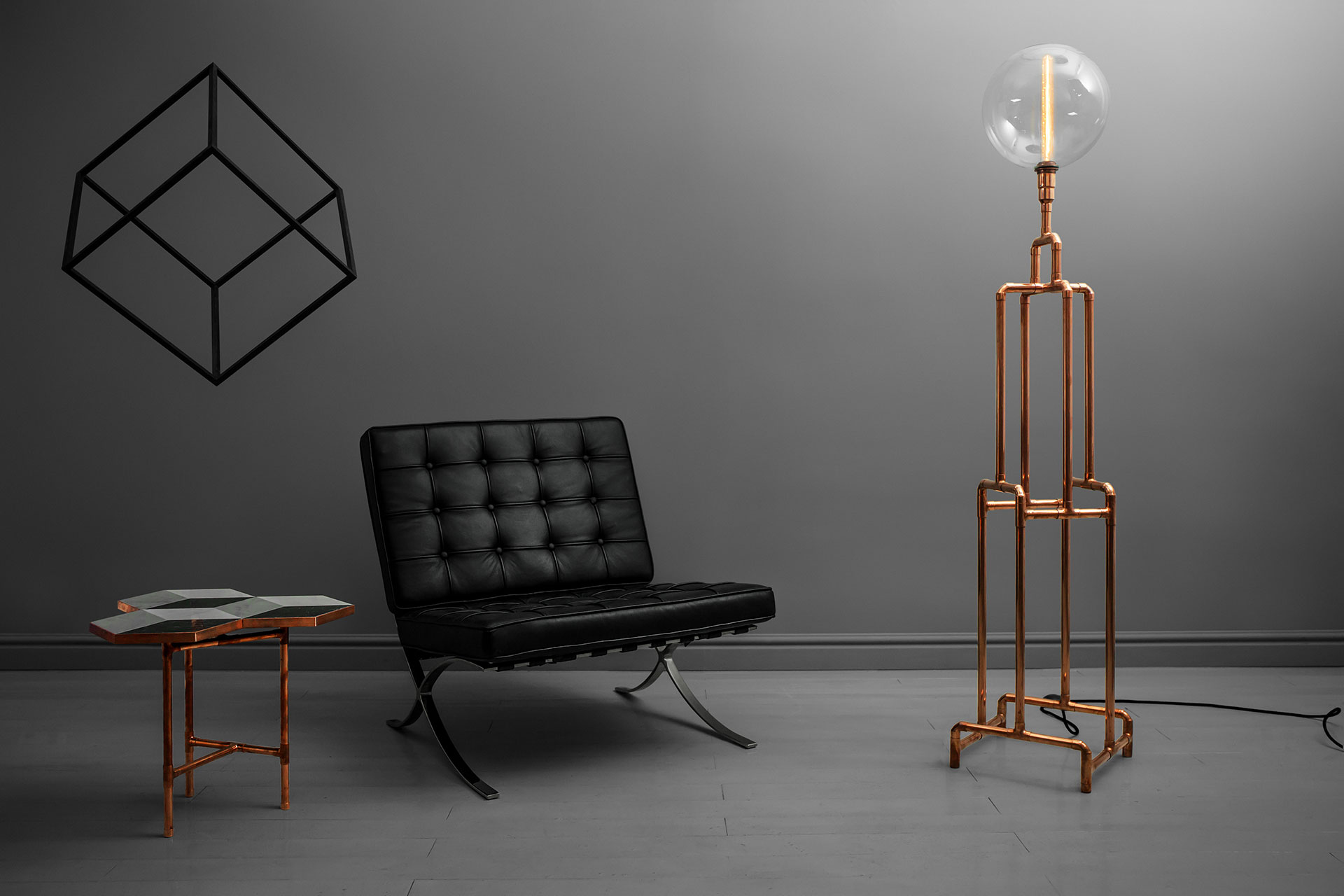 Steampunk design floor lamp with vintage Edison bulb in modern mens apartment