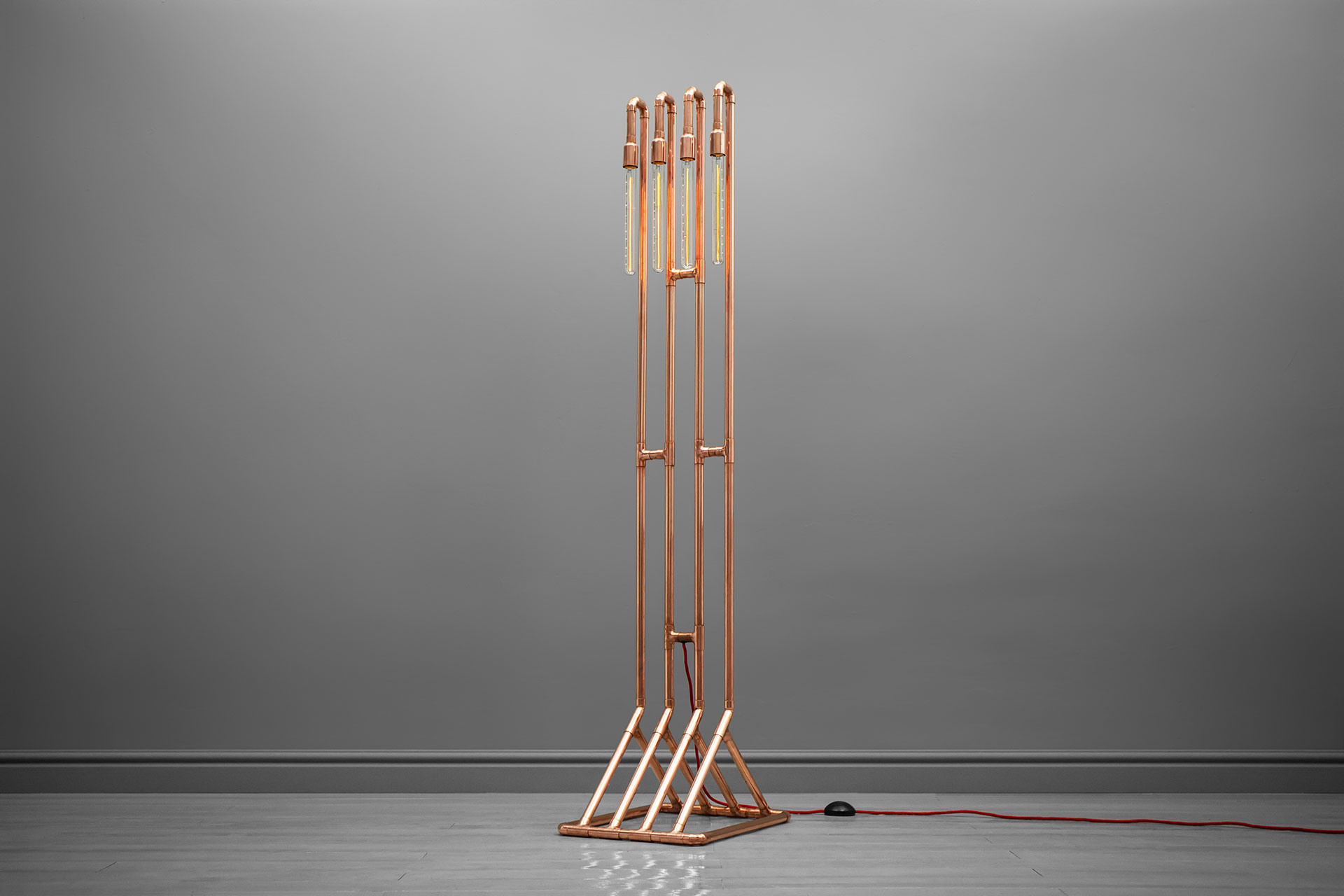 Unique floor lamp in loft style inspired by copper pipe art
