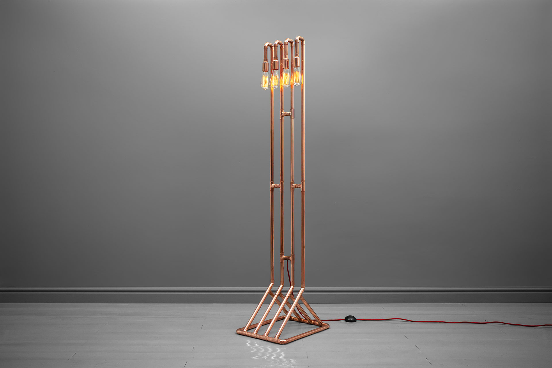 Decorative floor lamp in trendy copper or gold brass inspired by steampunk design