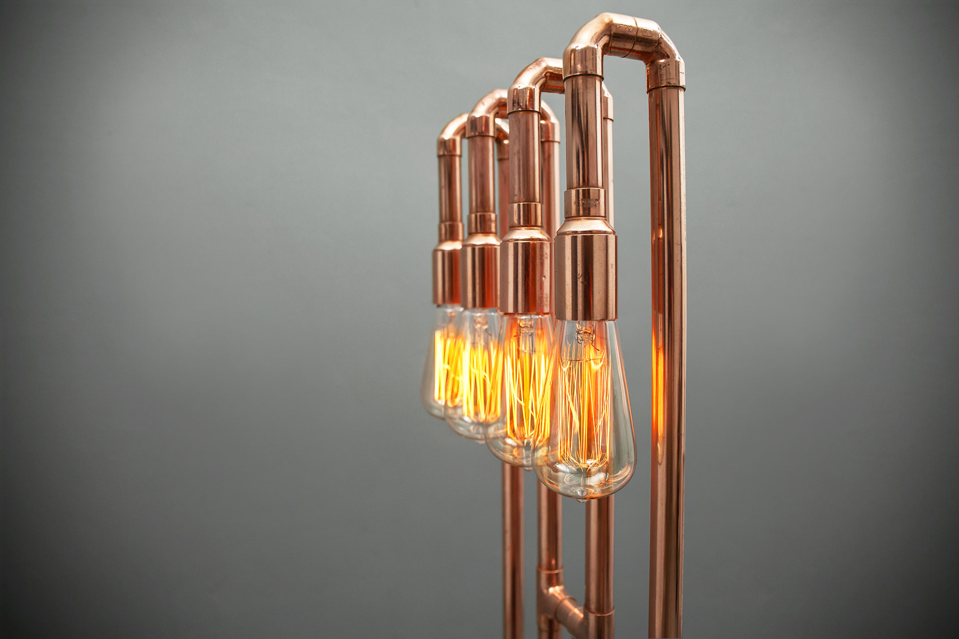 Vintage Edison bulbs in copper floor lamp inspired by loft style