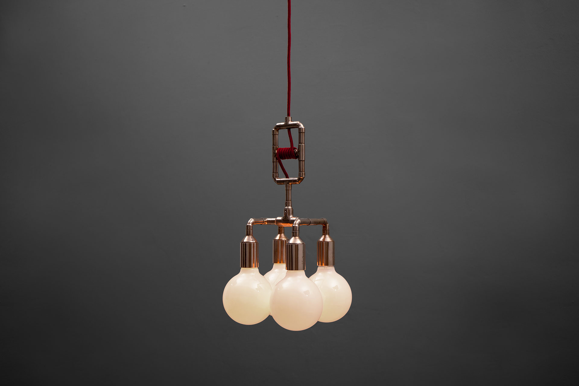 Adjustable height pendant lamp in copper or brass inspired by loft design