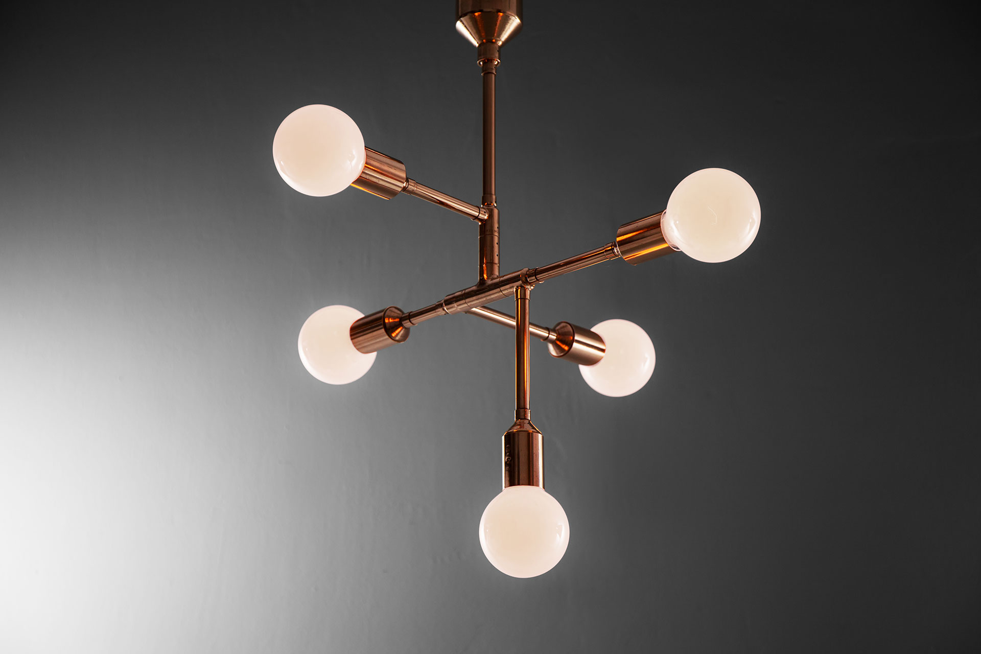 Designer lighting chandelier in copper or gold color