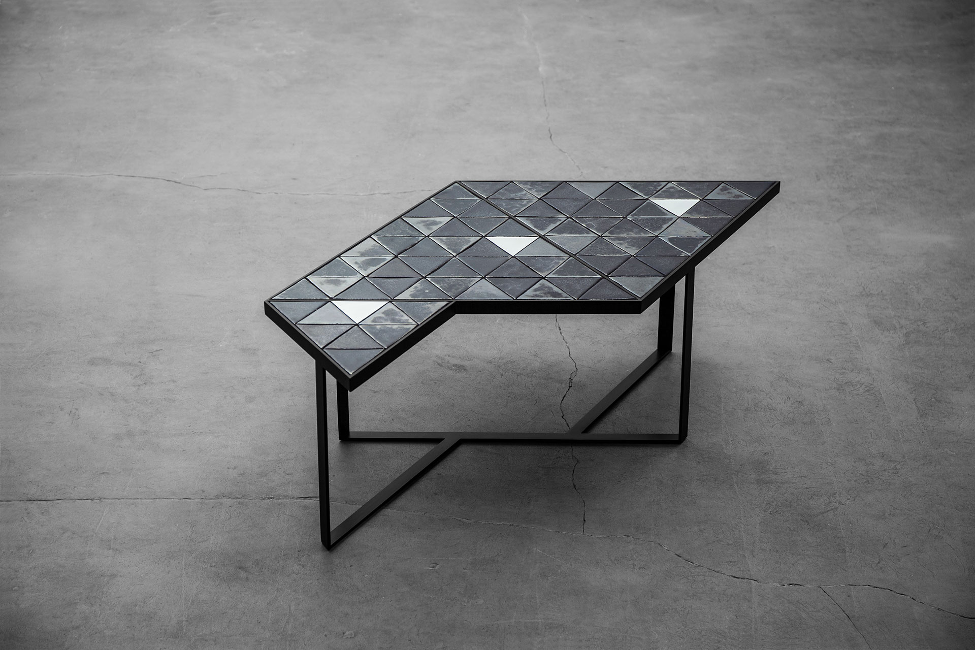 Black geometric coffee table inspired by brutalist design