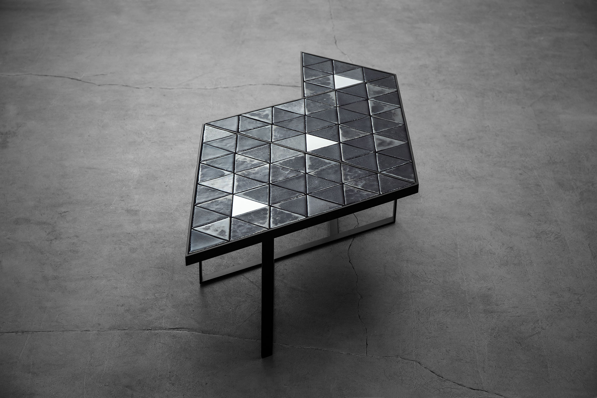 Triangular coffee table inspired by brutalist design