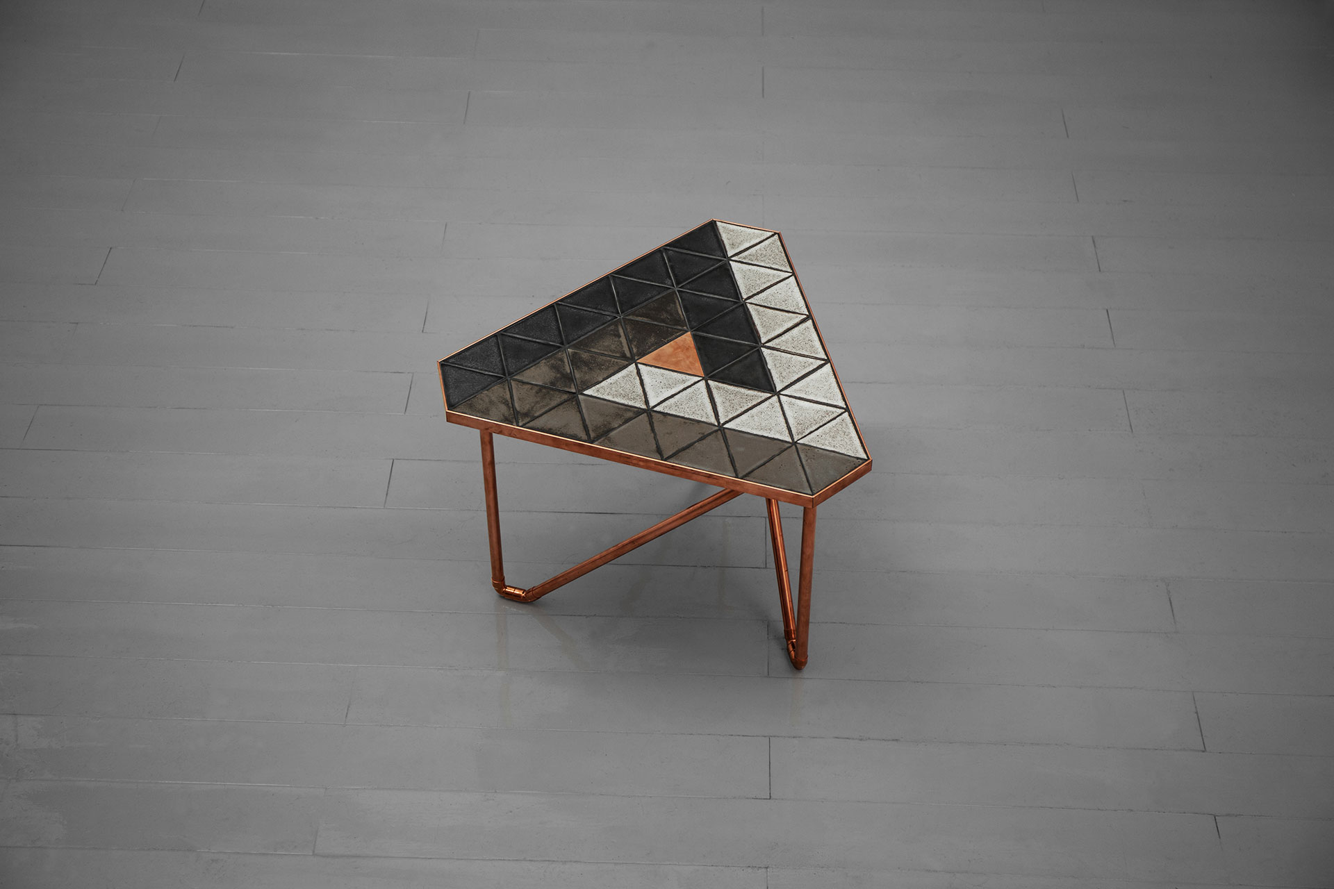 Small triangle shaped coffee table inspired by brutalist design