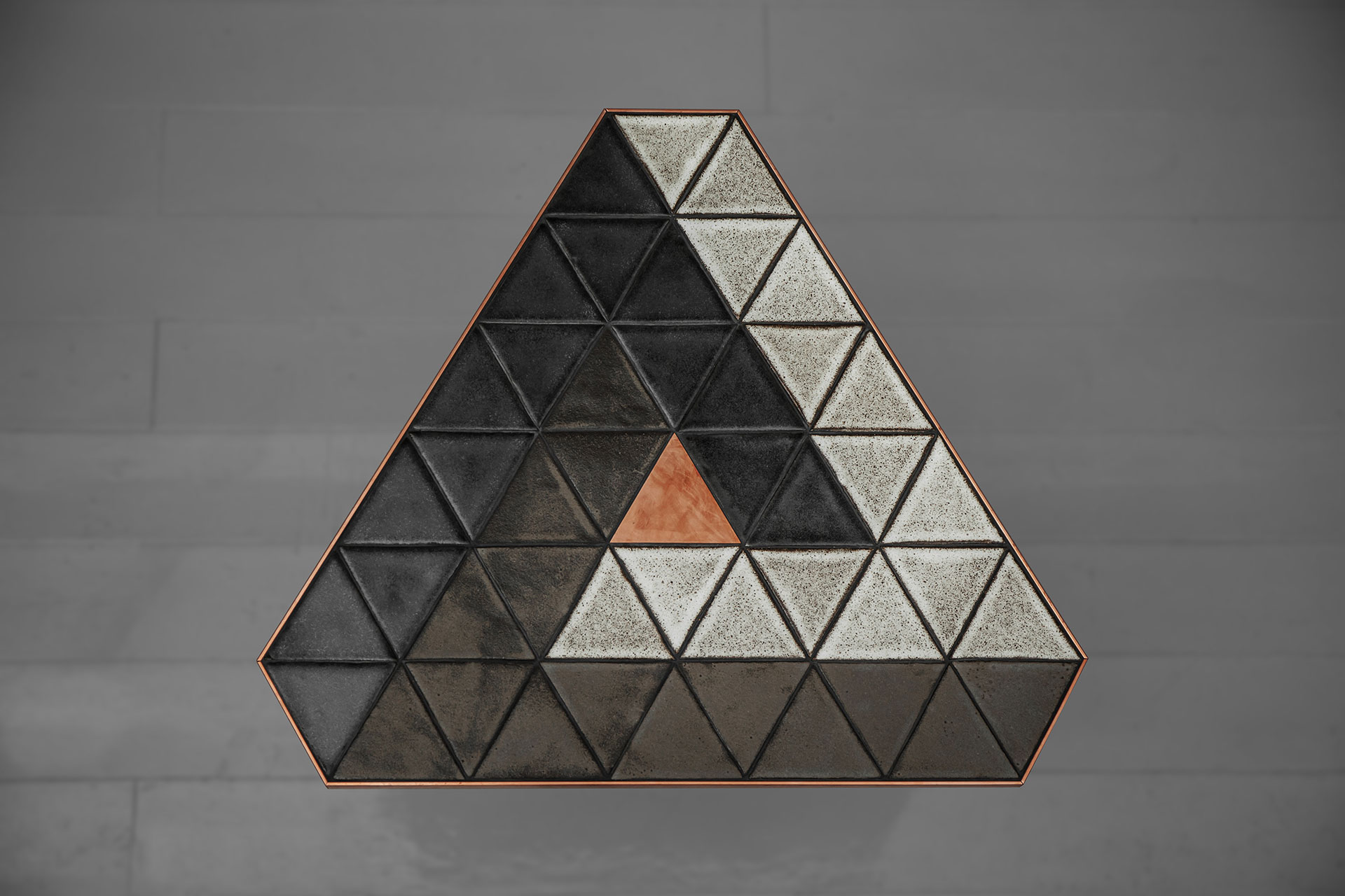 Ceramic side table inspired by Penrose triangle