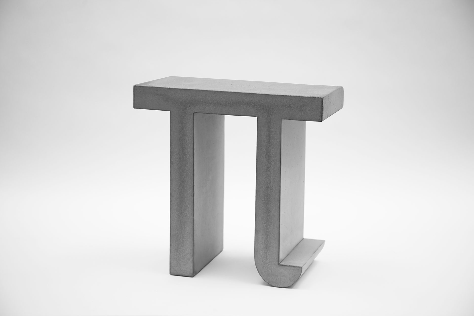 Geometric design Pi shaped stool from concrete