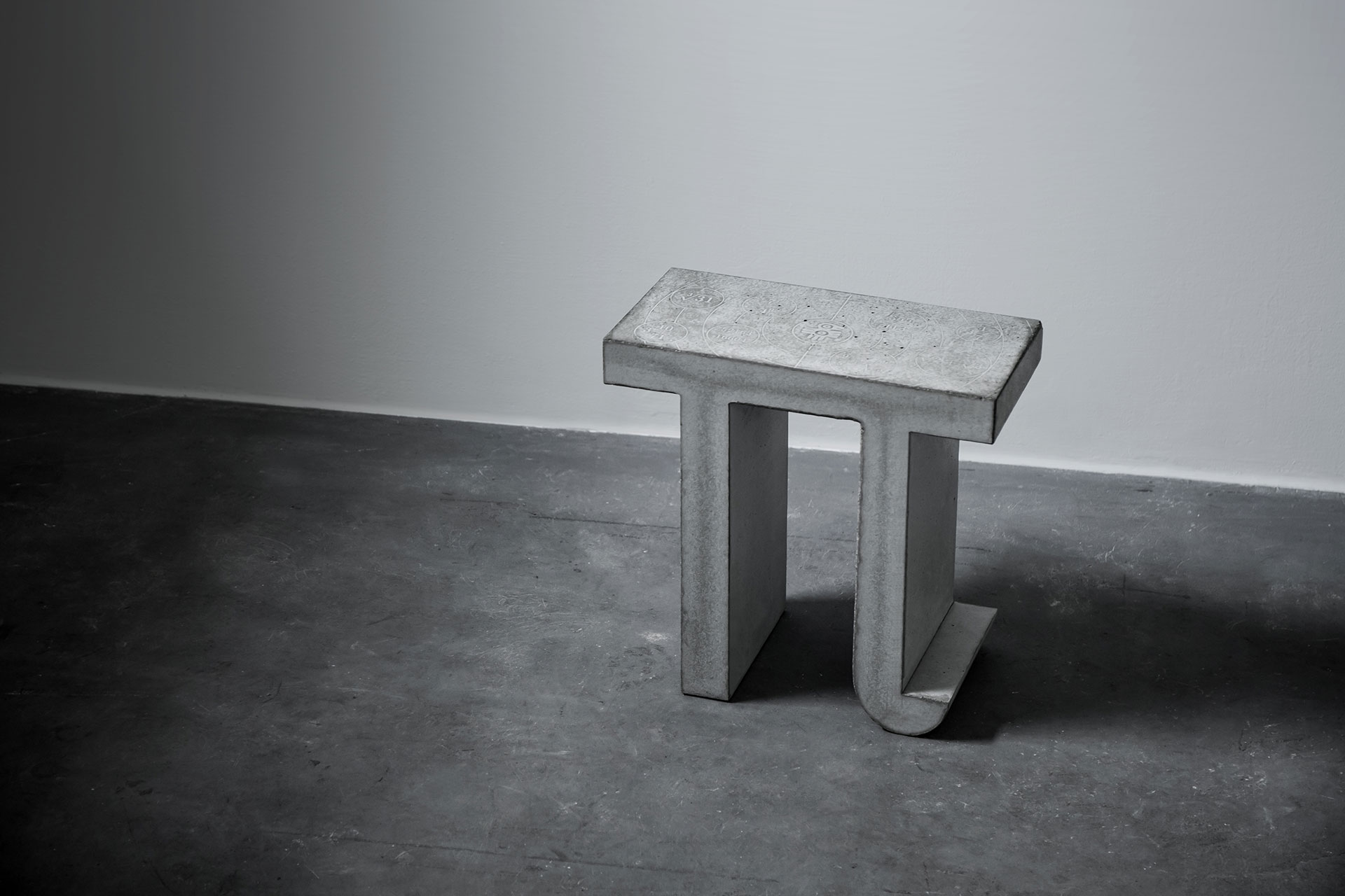 Brutalist concrete stool inspired by Pi number