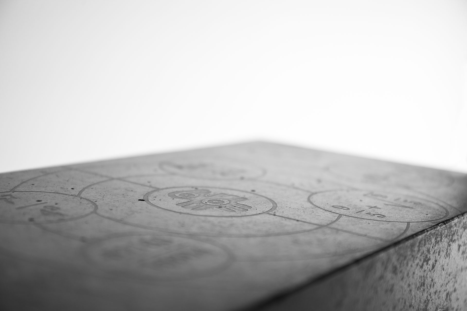Engraved top of the concrete stool