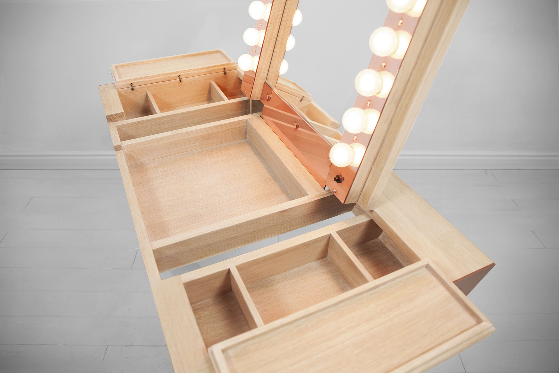Wooden vanity with makeup lights and folding mirror