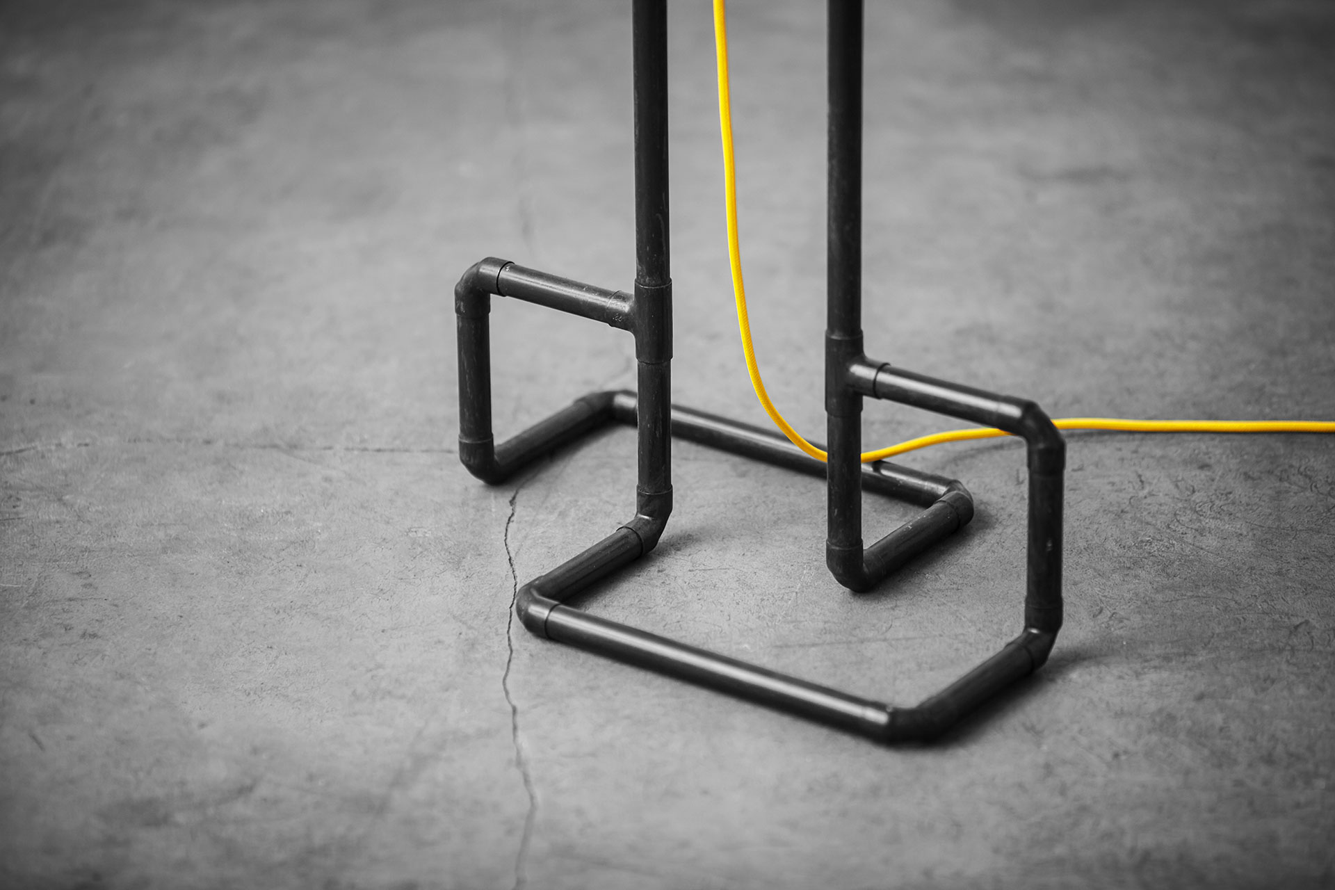 Designer floor lamp detail in black patina with yellow braided cord
