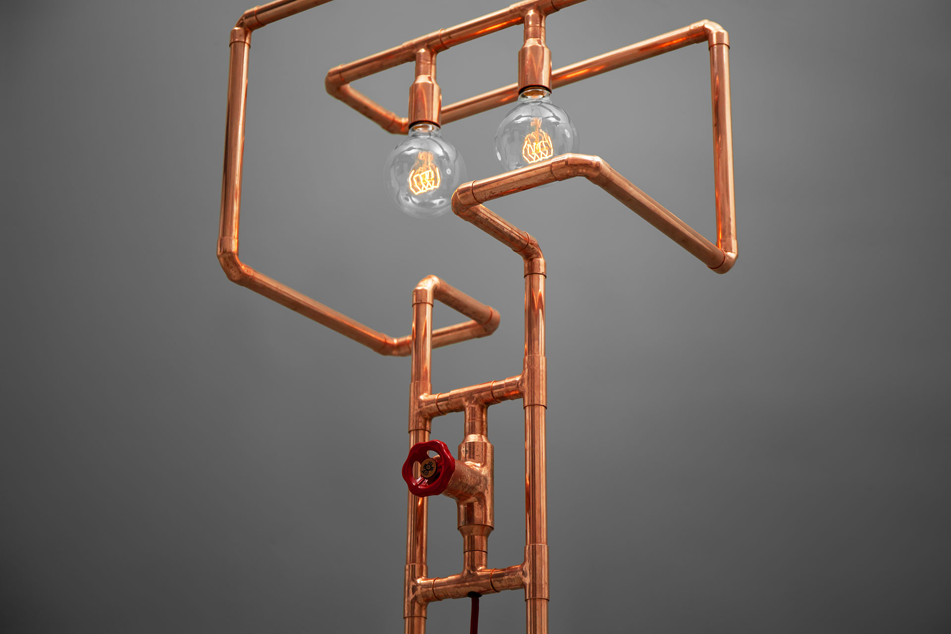 Creative design floor lamp in trendy copper or modern brass inspired by pipes installation