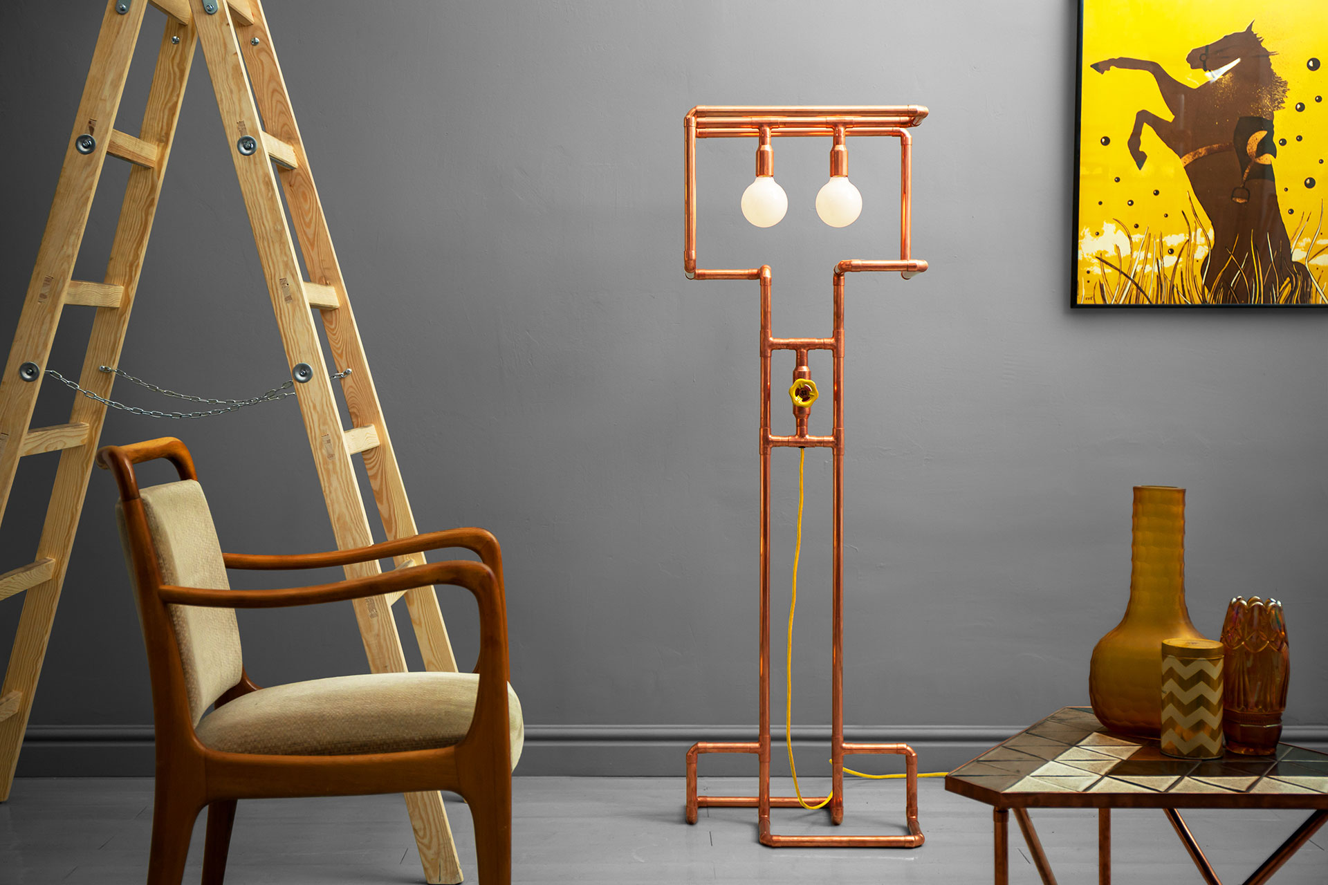 Unusual dimmable floor lamp made of trendy copper or modern brass in cozy hipster apartment