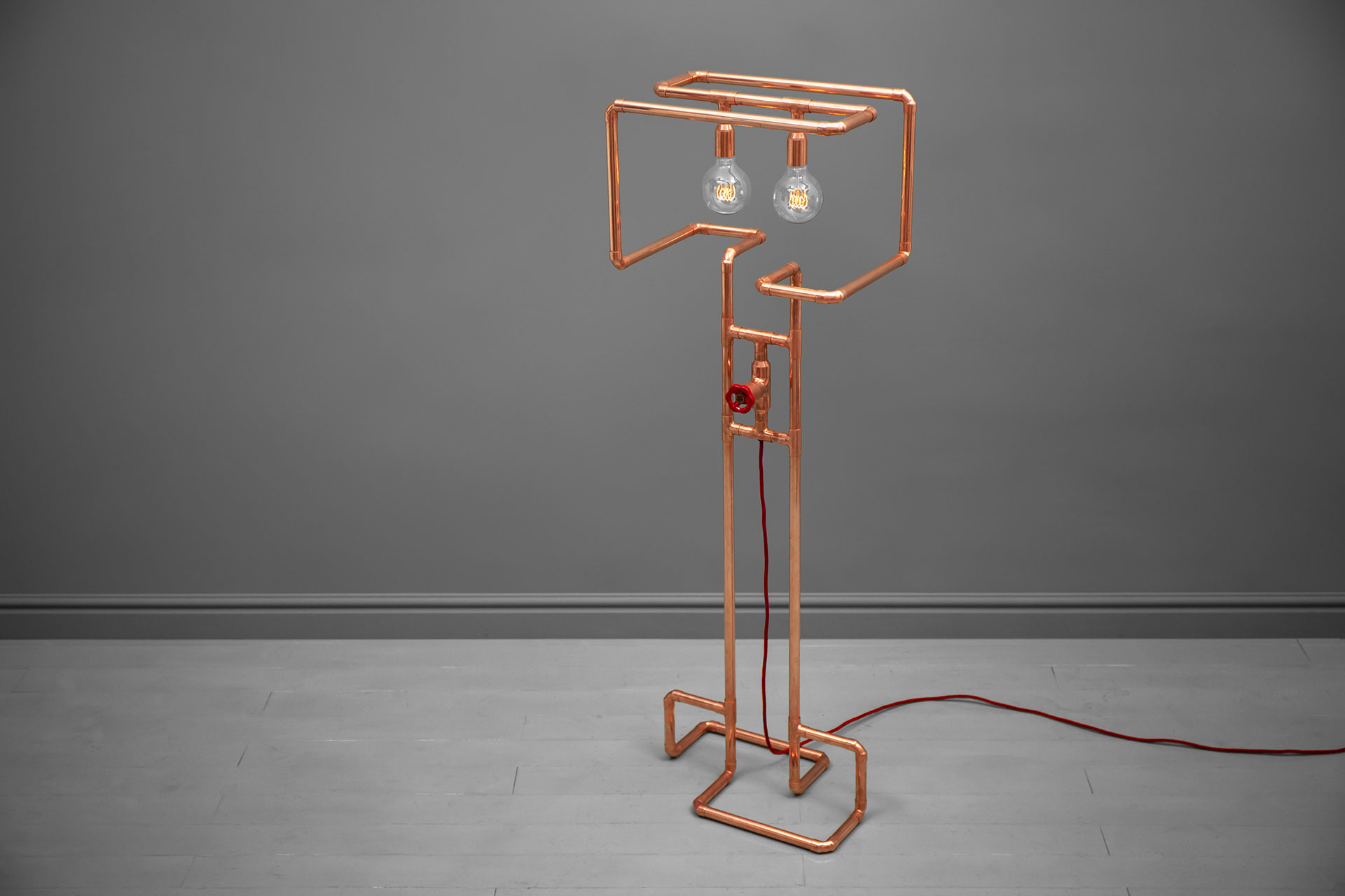 Copper pipes floor lamp with retro Edison bulbs inspired by steampunk design