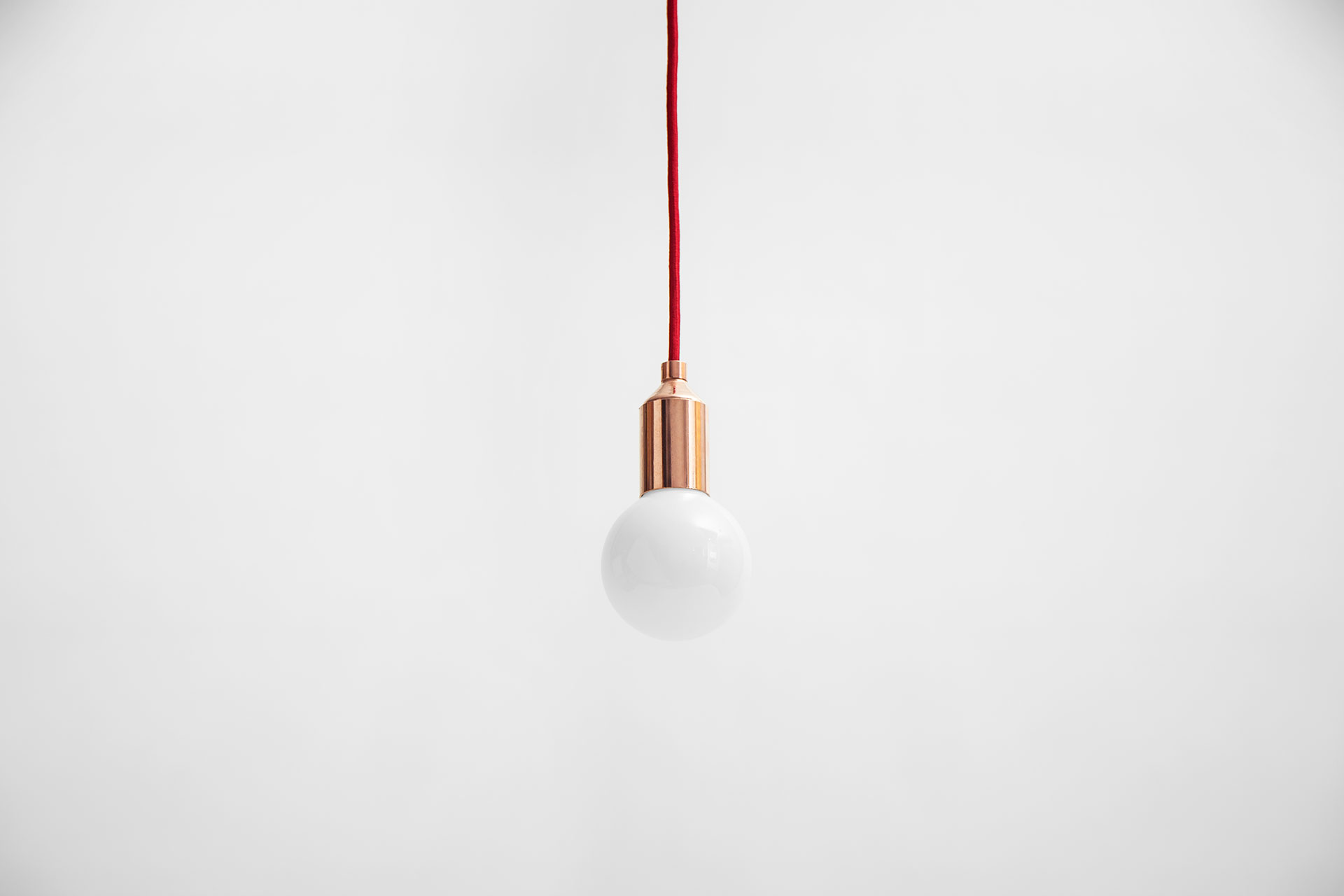 Simple copper pendant lamp in modern café