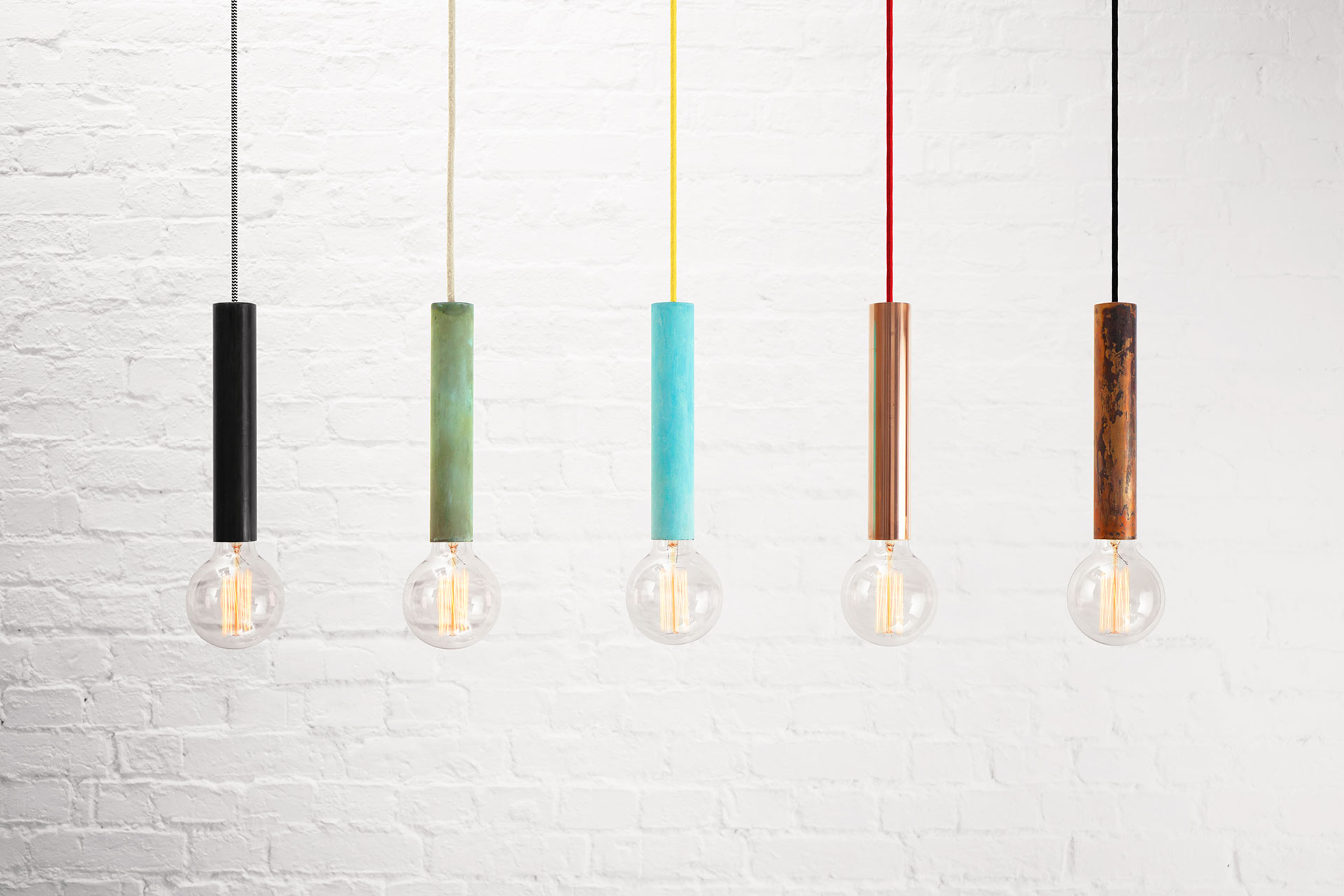 Modern pendant lamps in various trendy colors and colorful cords