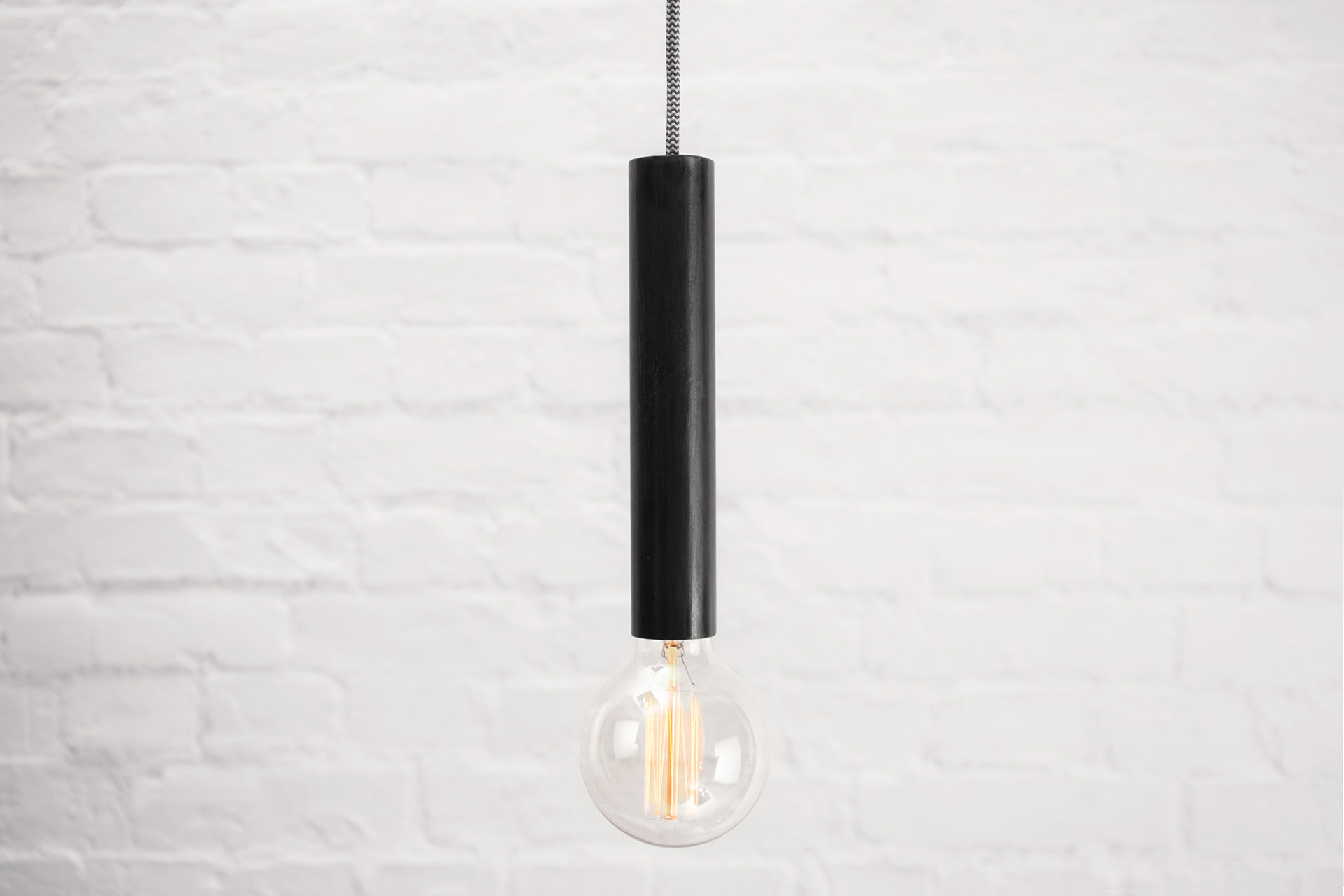 Industrial design pendant lamp in black patina with zig-zag cord and vintage Edison bulb