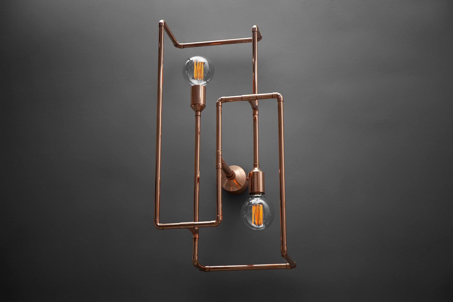 Large decorative copper sconce in loft style restaurant