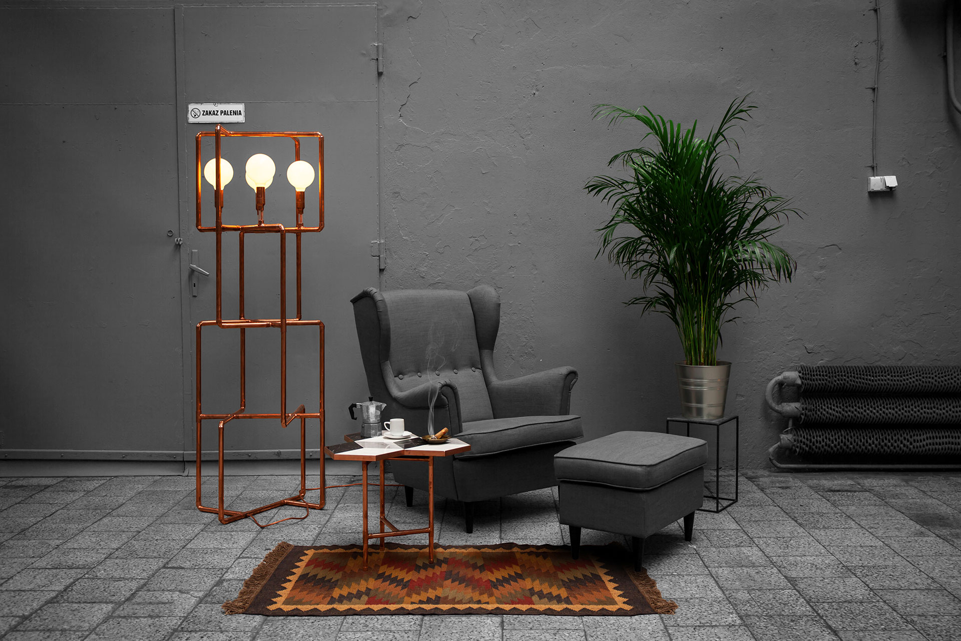 Decorative floor lamp made of trendy copper in loft style hotel lobby