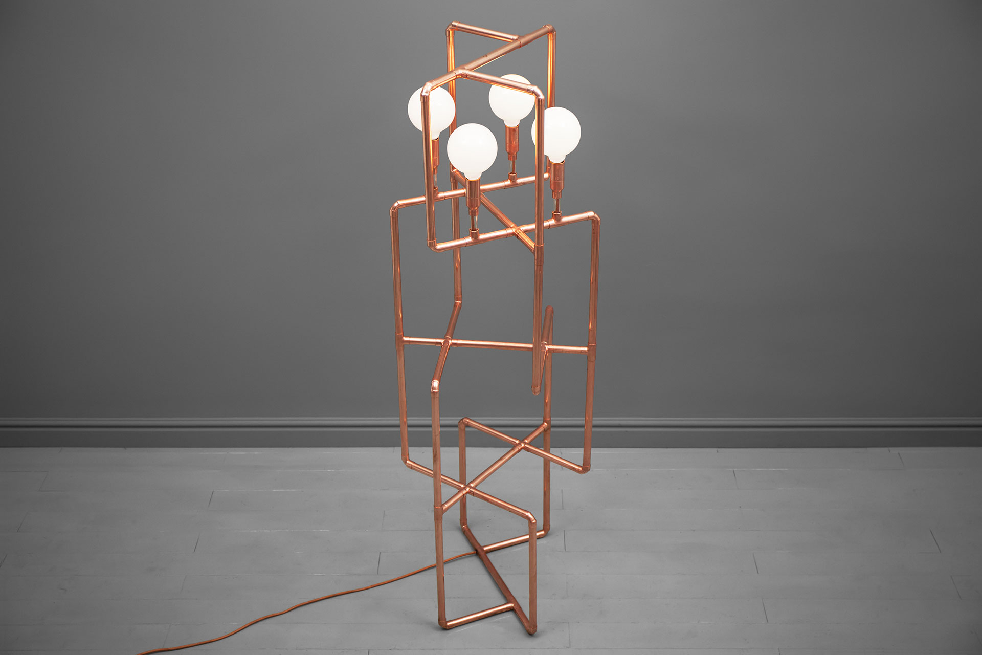 Custom floor lamp made of copper pipes inspired by industrial design