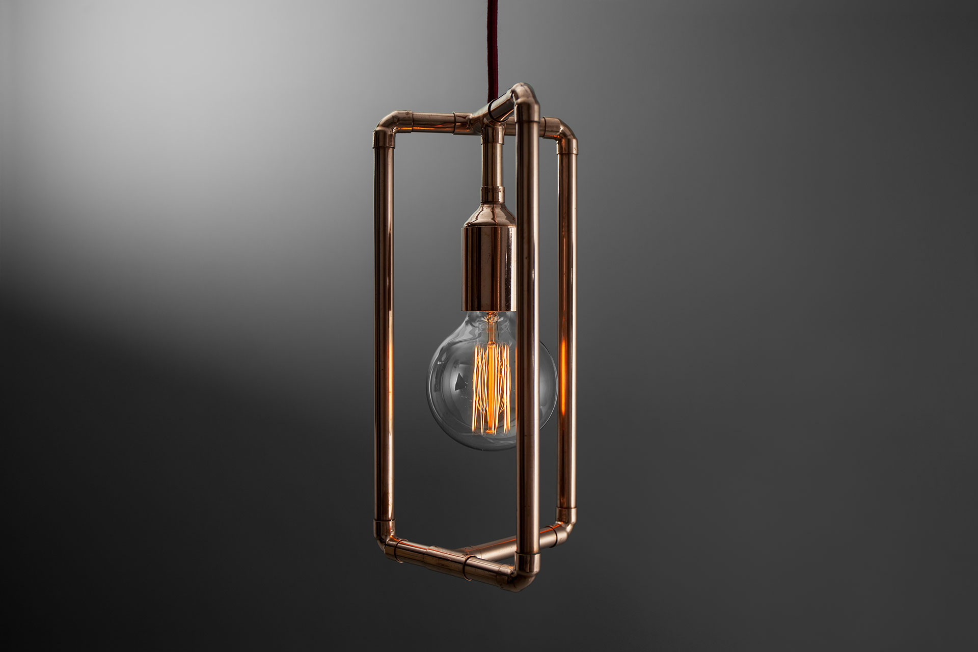 Industrial design pendant lamp in copper or brass with Edison bulb