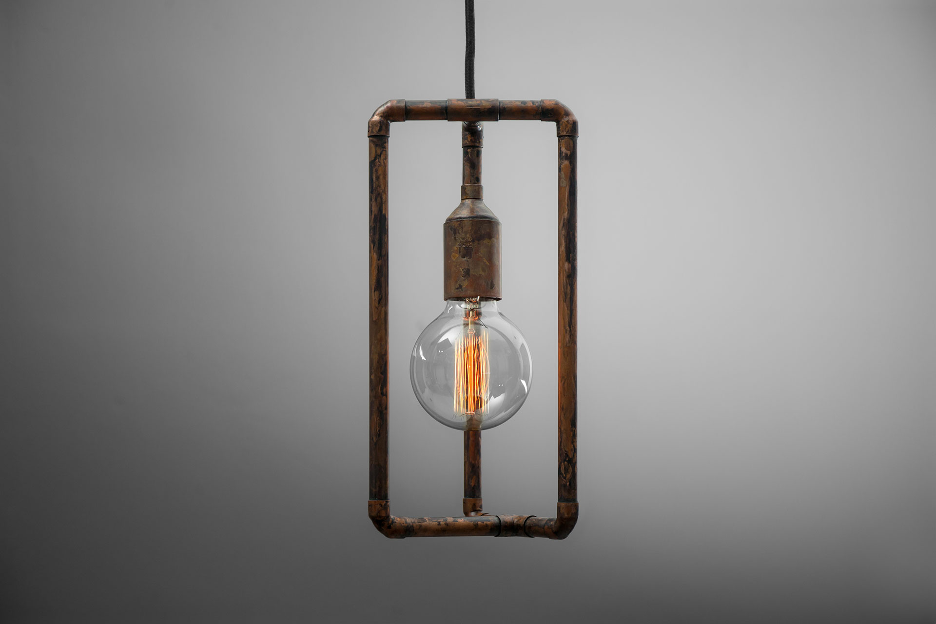 Rusty pendant lamp with vintage Edison bulb inspired by industrial design