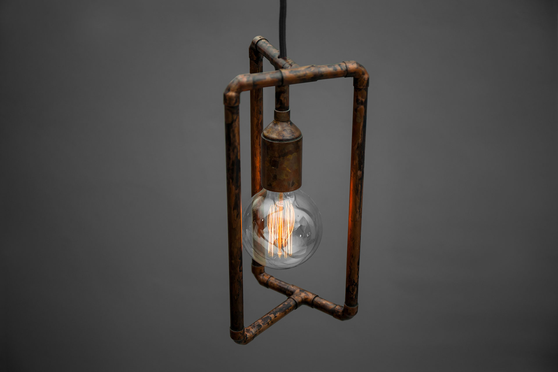 Vintage industrial ceiling lamp in aged copper metal finish
