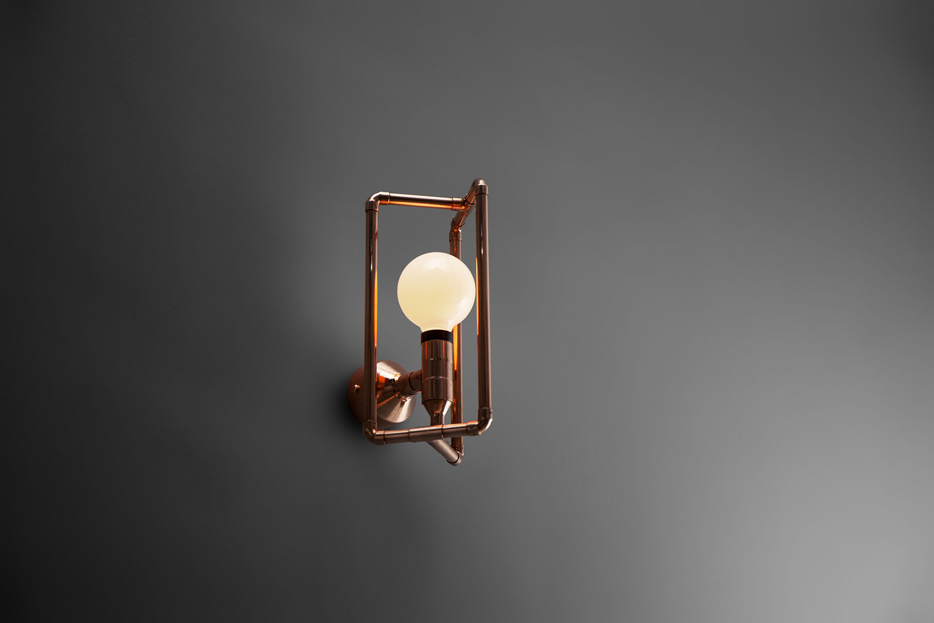 Modern design sconce in brass or copper inspired by industrial style