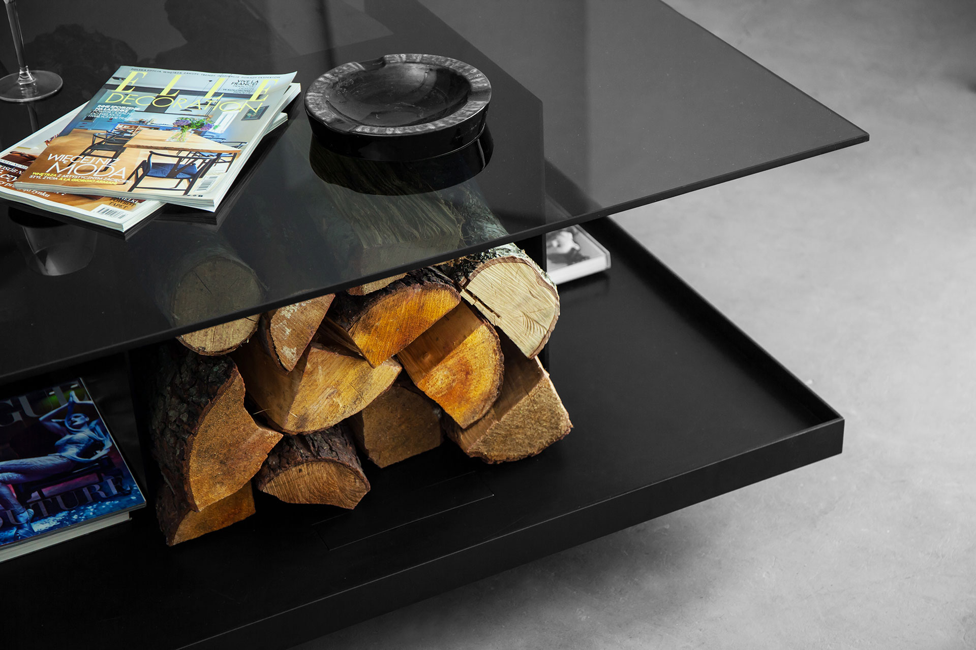 Log storage coffee table inspired by minimalist architecture