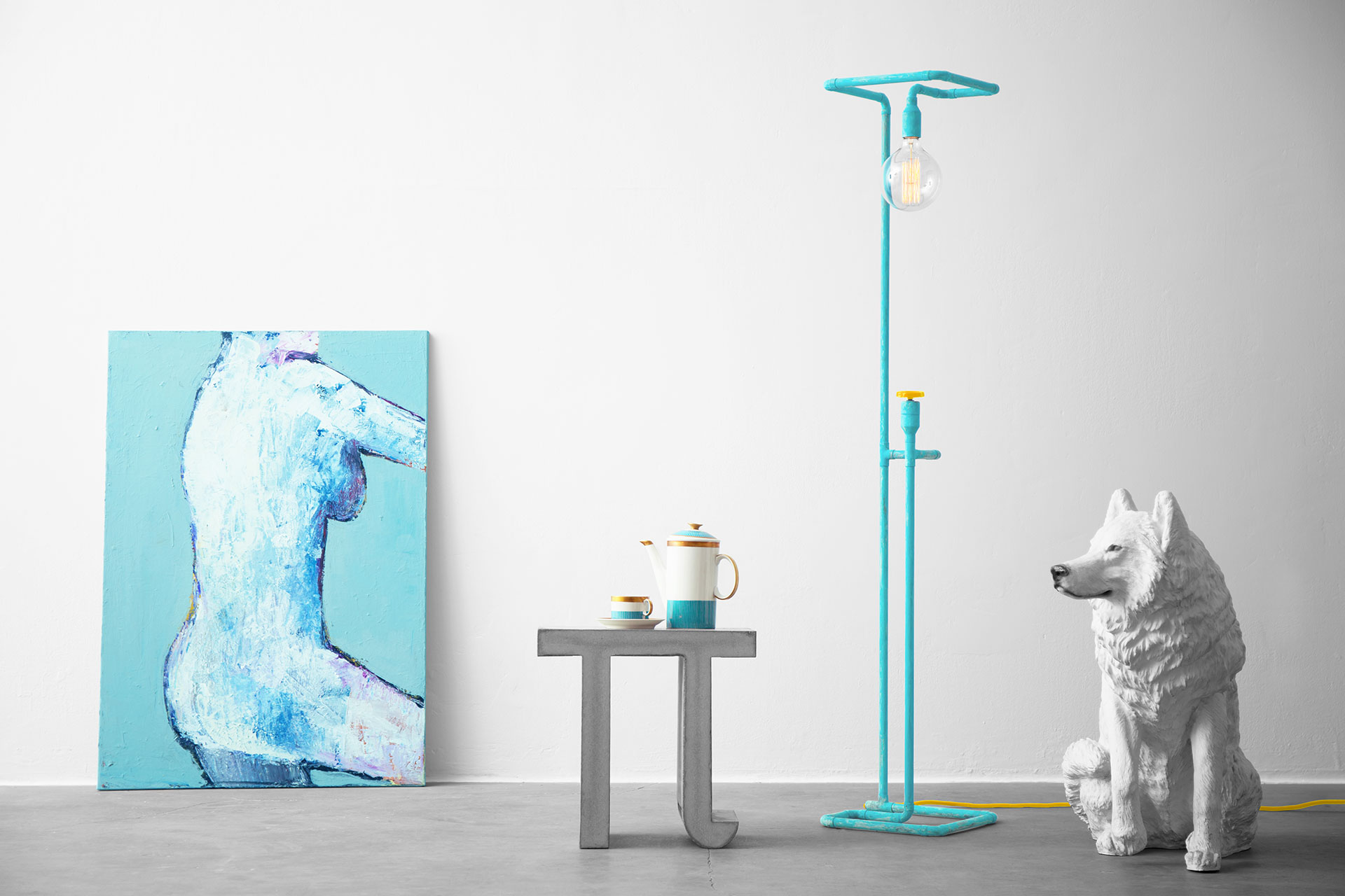 Unique dimmable floor lamp in colorful turquoise patina in trendy loft apartment