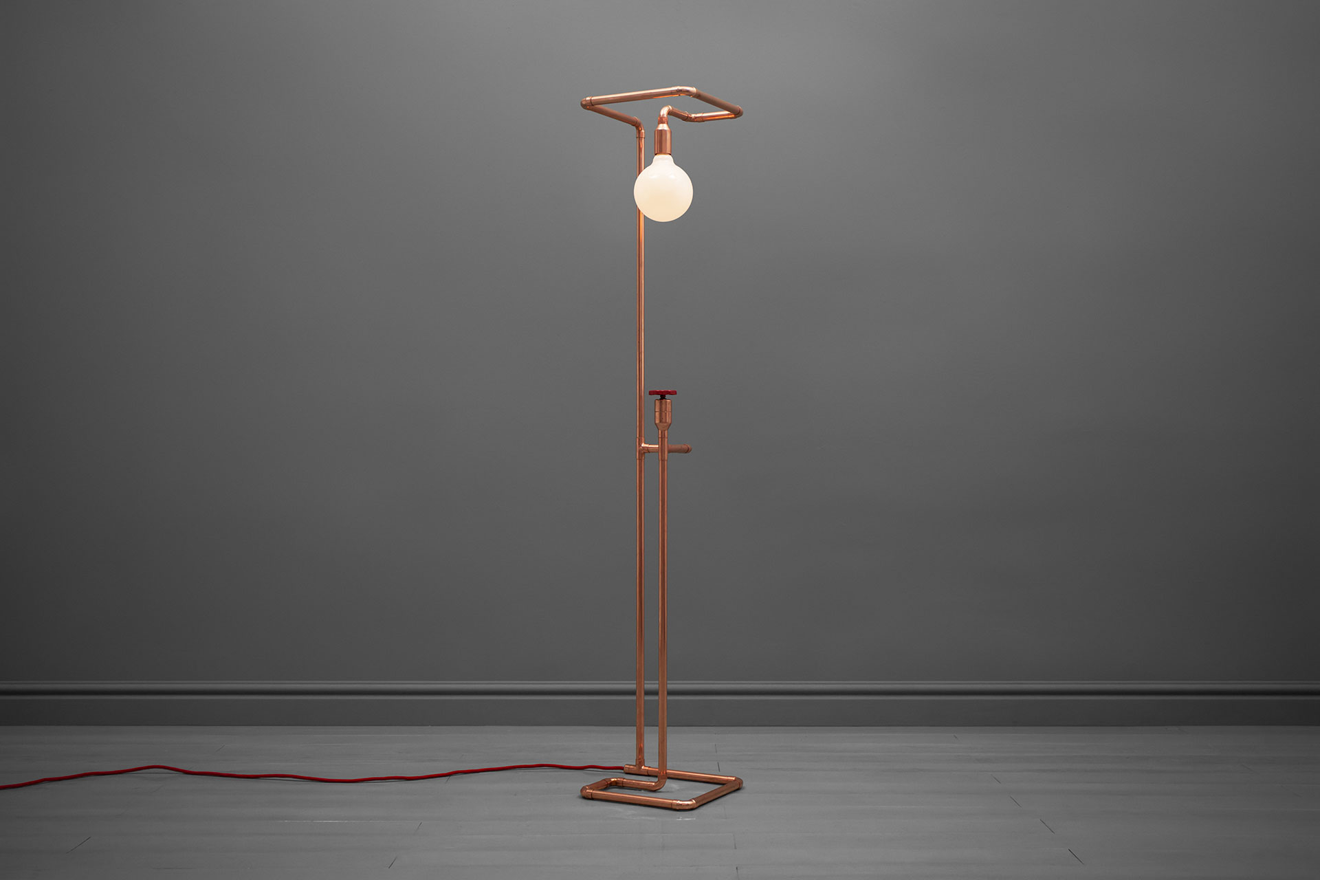 Industrial design copper tubing floor lamp inspired by installation art