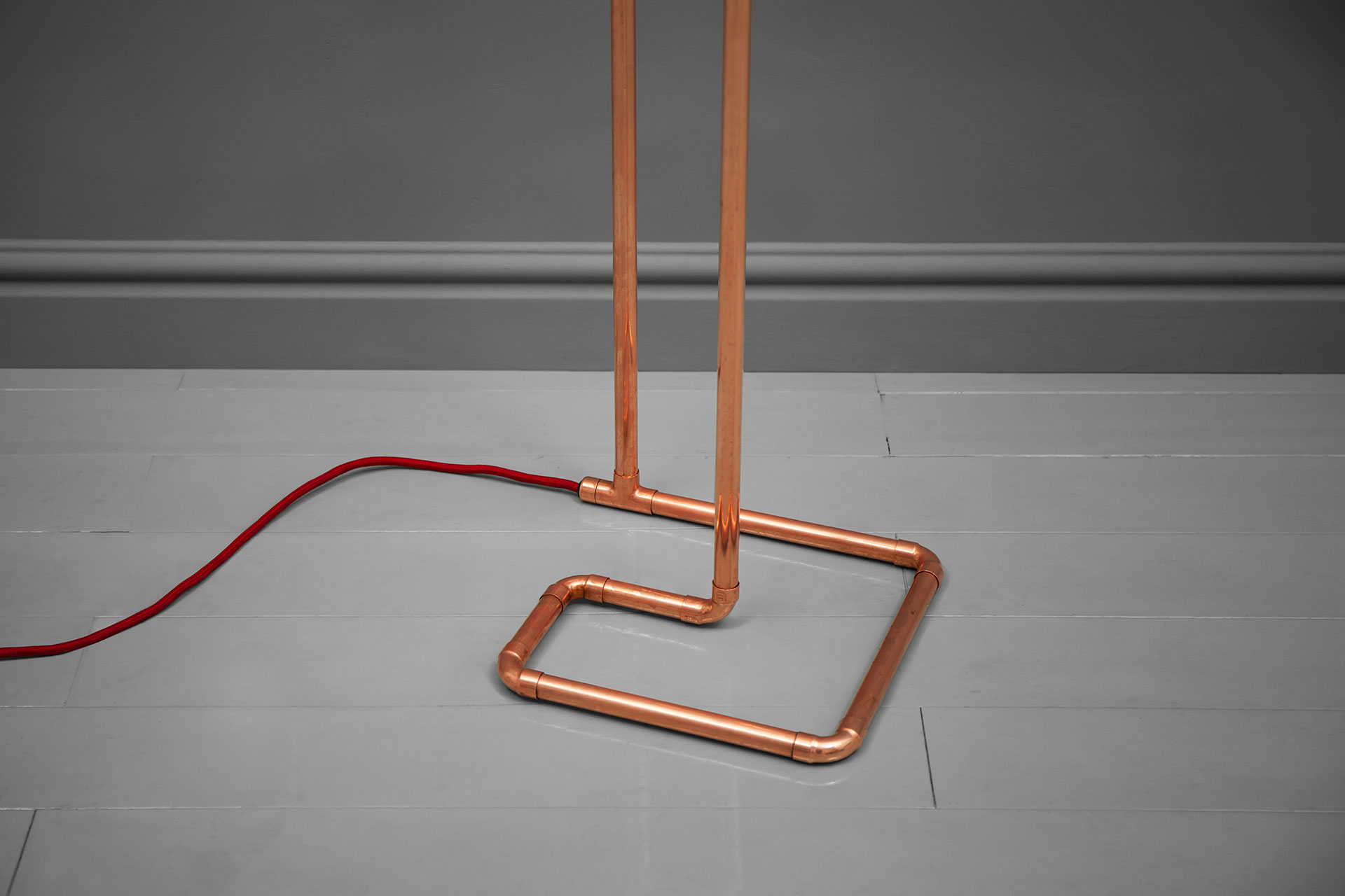 Detail of the copper tubing floor lamp with red braided cord