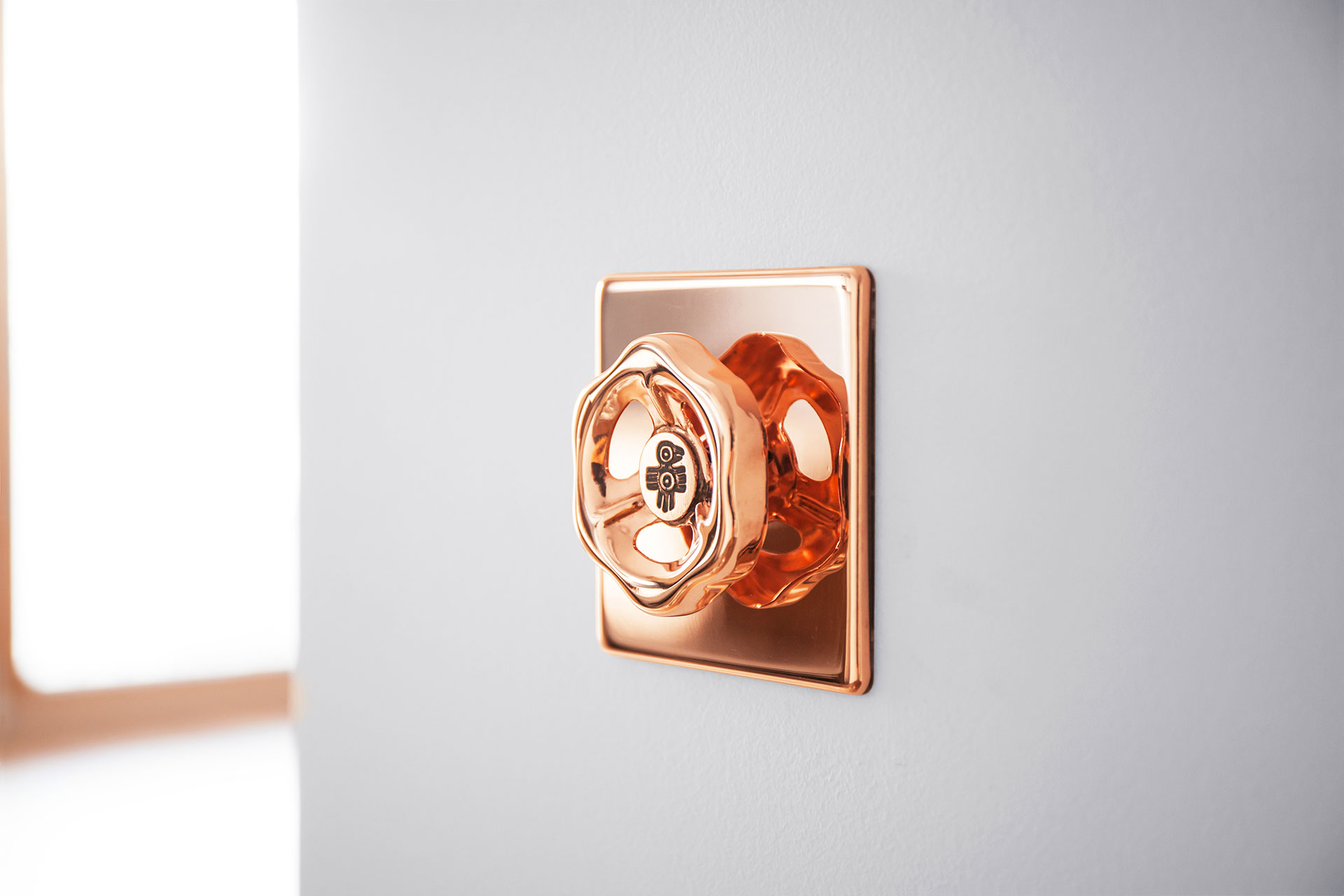 Wall dimmer light switch in fashionable copper metal finish for loft style interiors