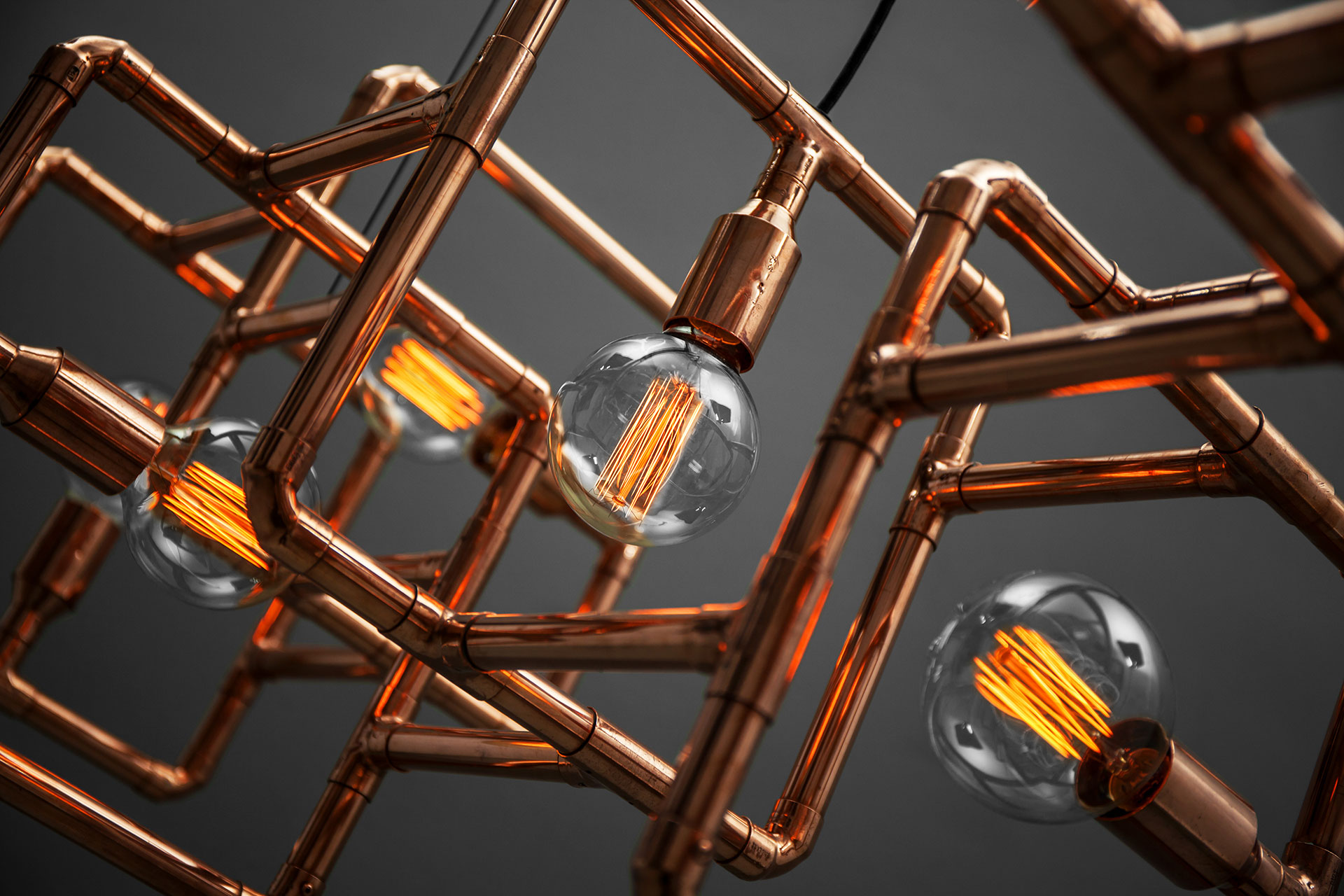 Unique ceiling lamp inspired by copper pipe art