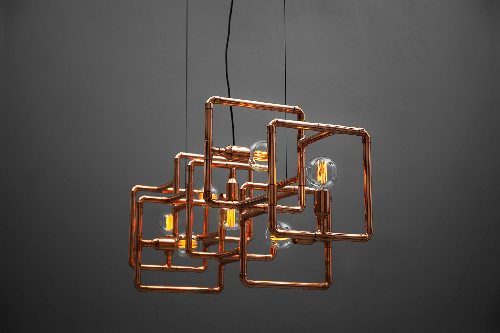 Custom lighting in copper inspired by brutalist architecture