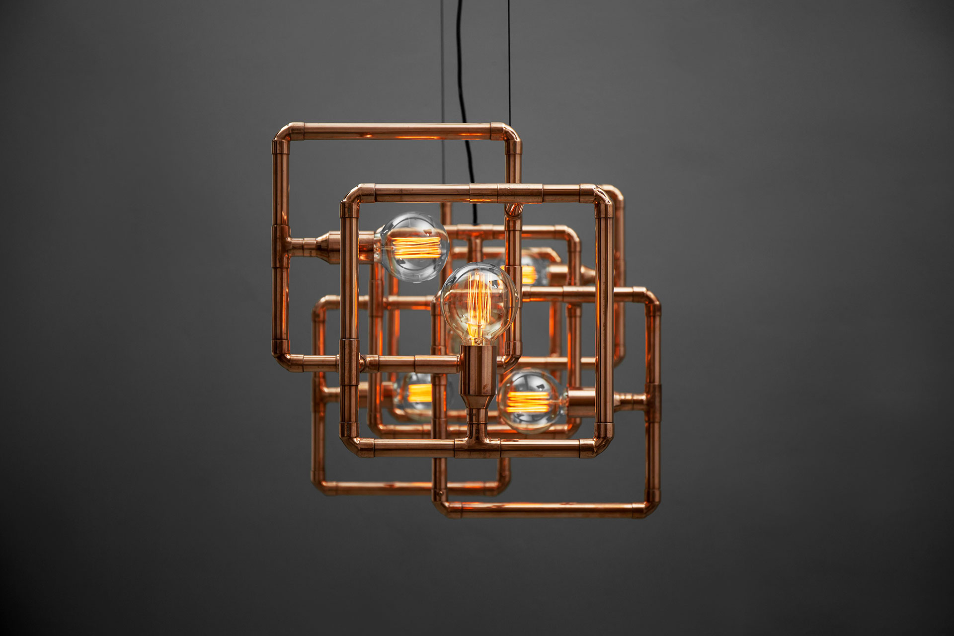 Dining table ceiling lamp in trendy copper inspired by geometric design