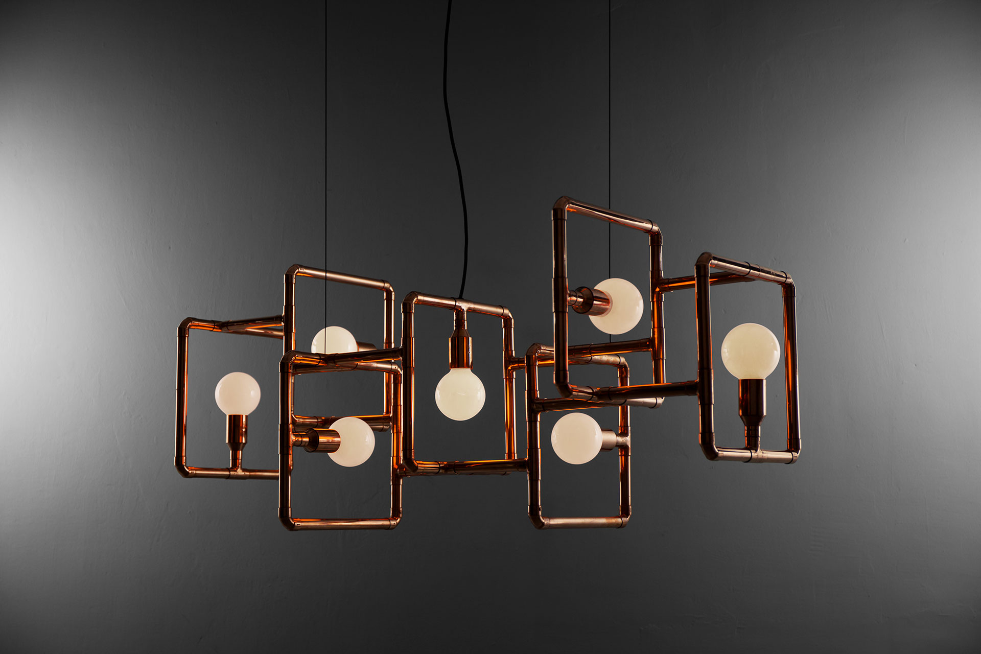 Conceptual design ceiling lamp made of copper tubing in industrial style interior