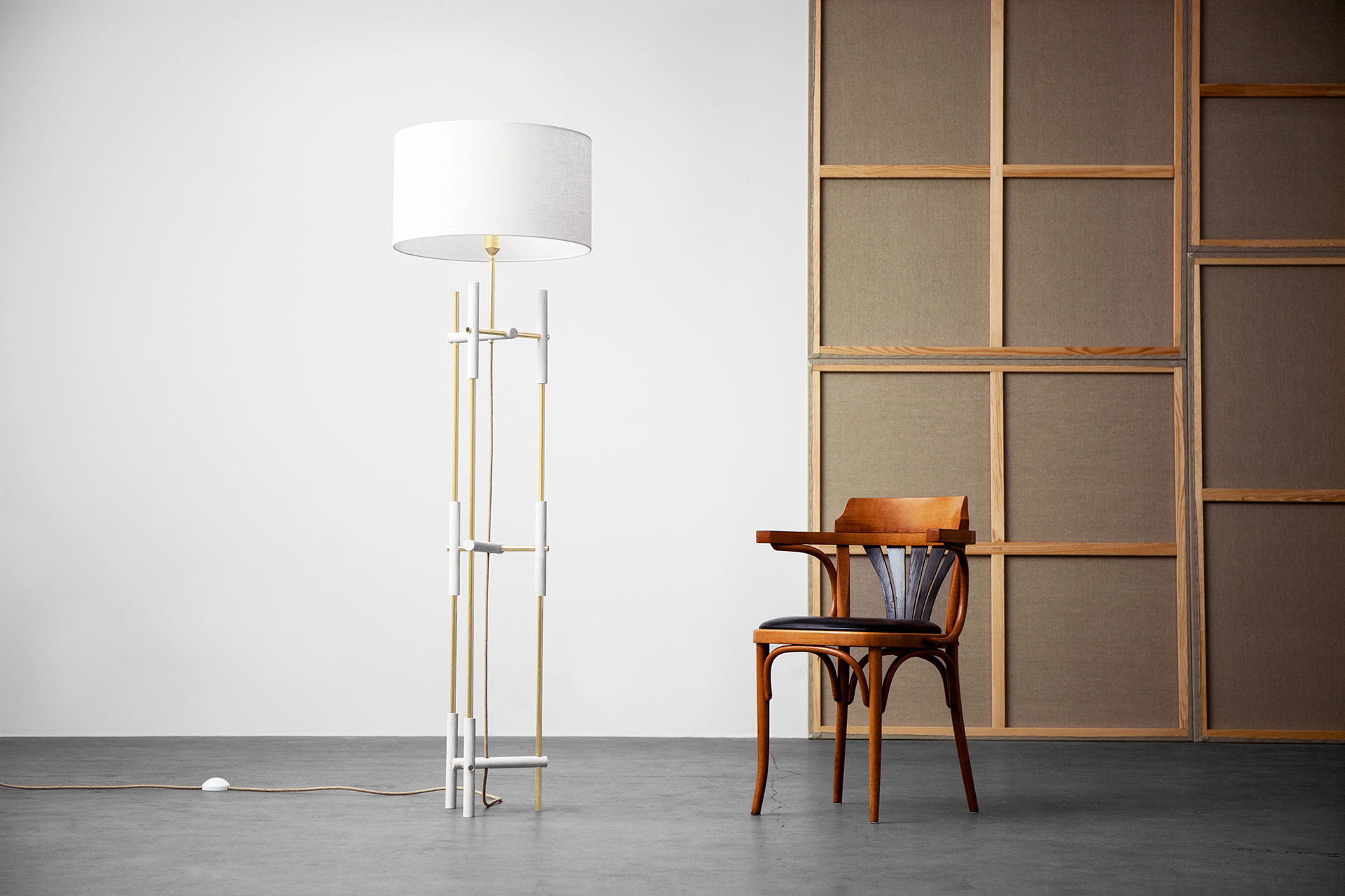 Modern design brass floor lamp with white shade in loft