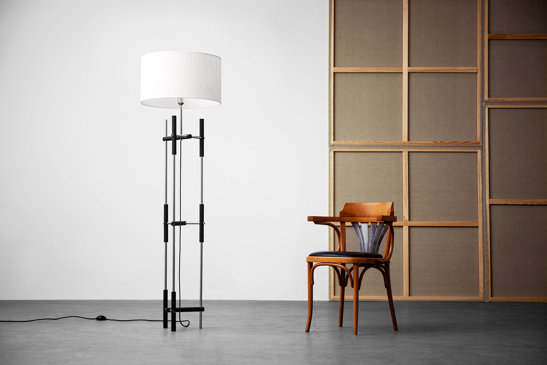 Modern design floor lamp with white shade in loft apartment